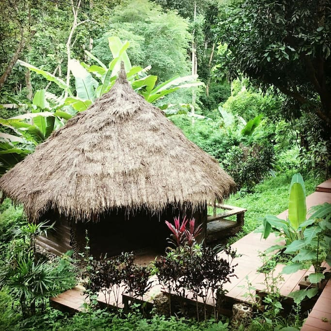 BAMBOO HUT 1   1-2 Guests   • Queen Bed • Mosquito net canopy • Ensuite bathroom • Outdoor seating area • Breakfast included • Fan