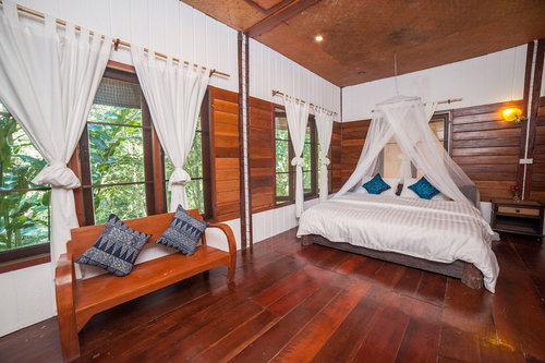 RIVERVIEW CABIN 4 (A/C)   1-5 Guests   • Queen Bed • Mosquito net canopy • Ensuite bathroom • Outdoor seating area • Breakfast included • Mini-fridge • A/C  *some can add up to 3 extra beds