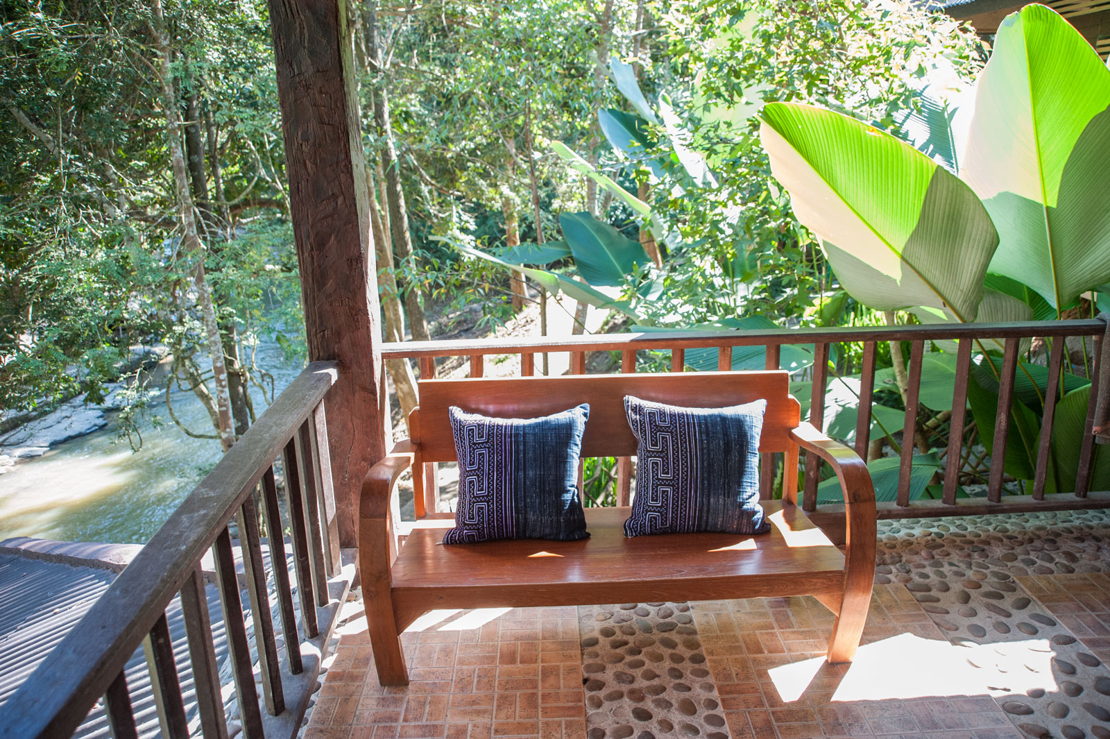 BAMBOO CABIN   1-5 Guests   • Queen Bed* • Mosquito net canopy • Detached, private bathroom • Outdoor seating area • Breakfast included • Fan  *can add up to 3 extra beds