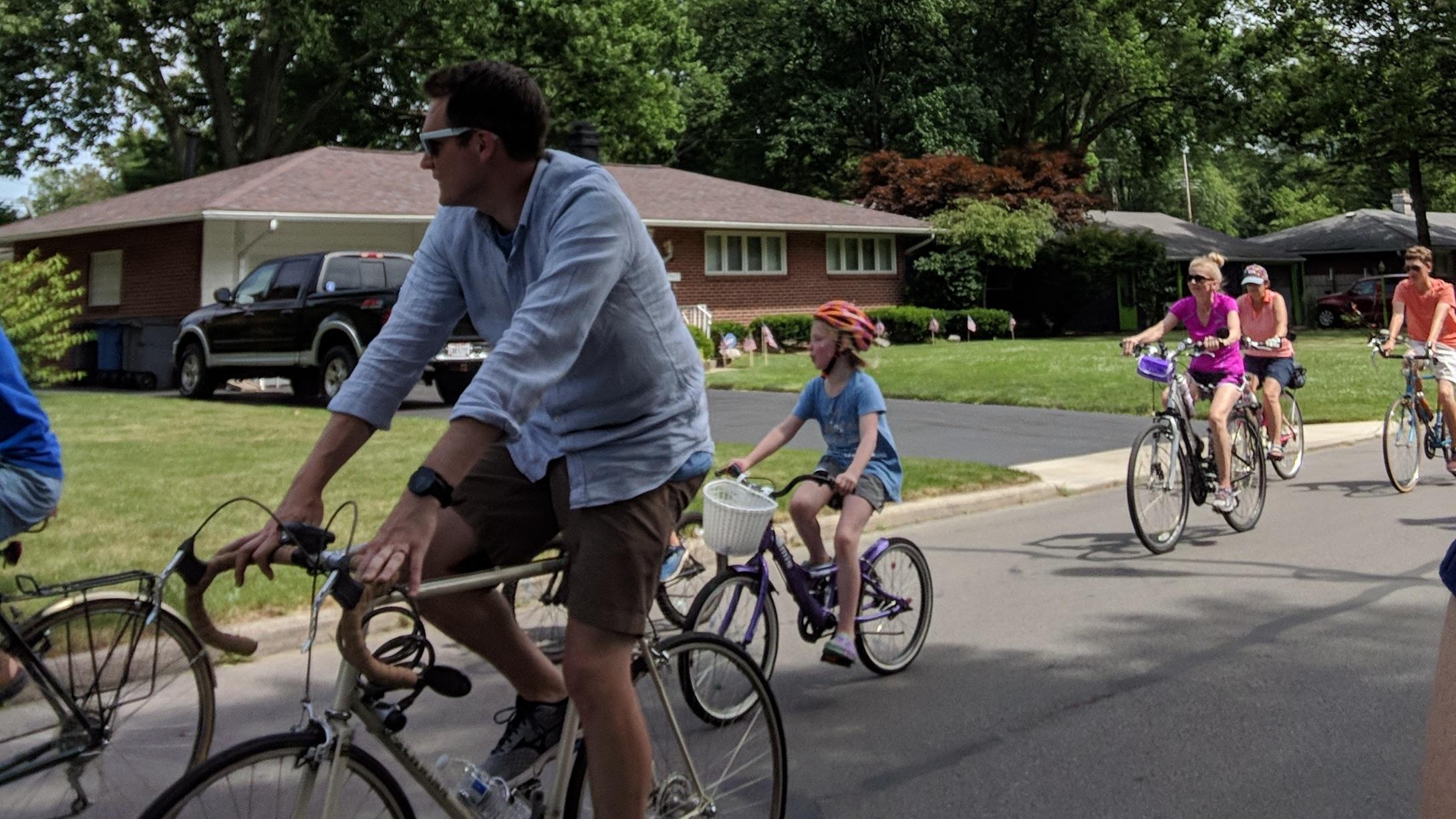 Sam leads a neighborhood bike ride promoting safe bike routes through Toledo.