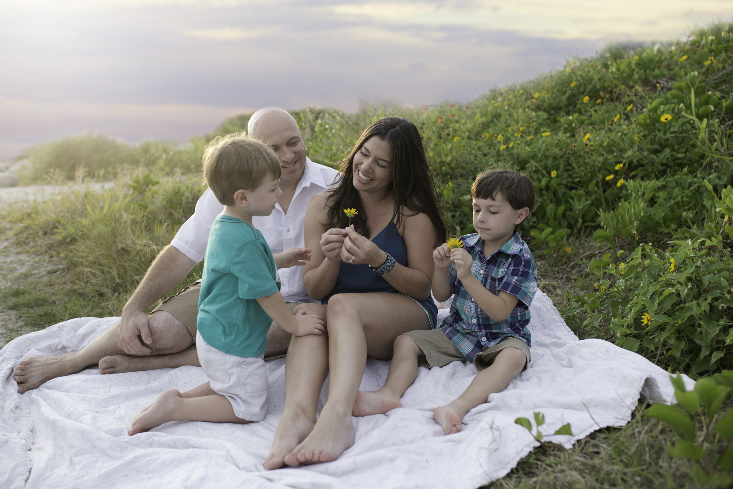 Richmond Family Photographer cute family plays with wildflowers