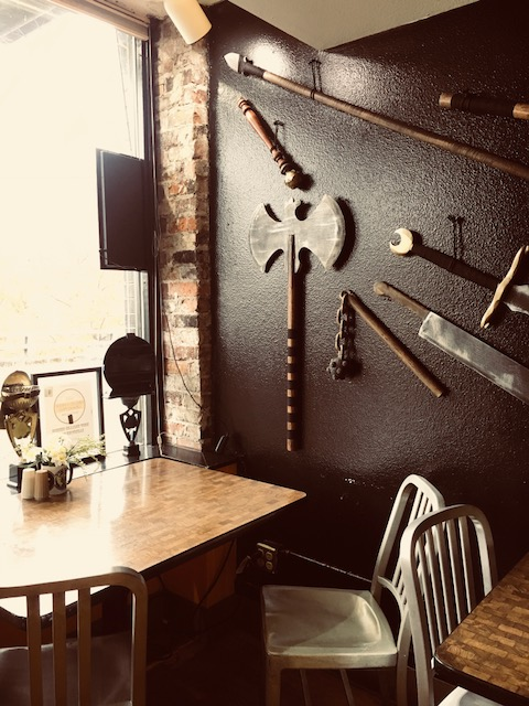 Medieval Weapons on the walls of Cheese Wizards / Photo Credit: Bella Stephens