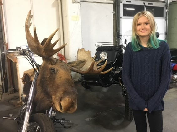 "Bella standing next to Macklemore's chopper at The Shop, located in Seattle's SODO neighborhood. If you decide to visit, check out Ethan Stowell's restaurant ""Derby"" next door."