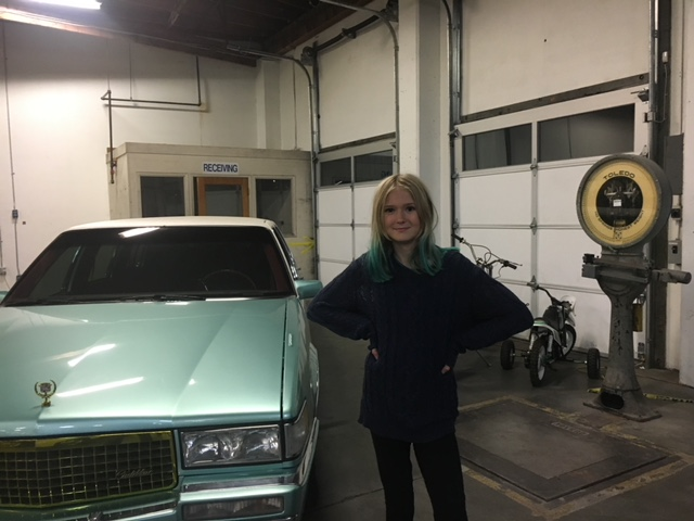 """Me, standing next to Mackelmore's collectible Cadillac at """"The Shop"""" in SODO."""
