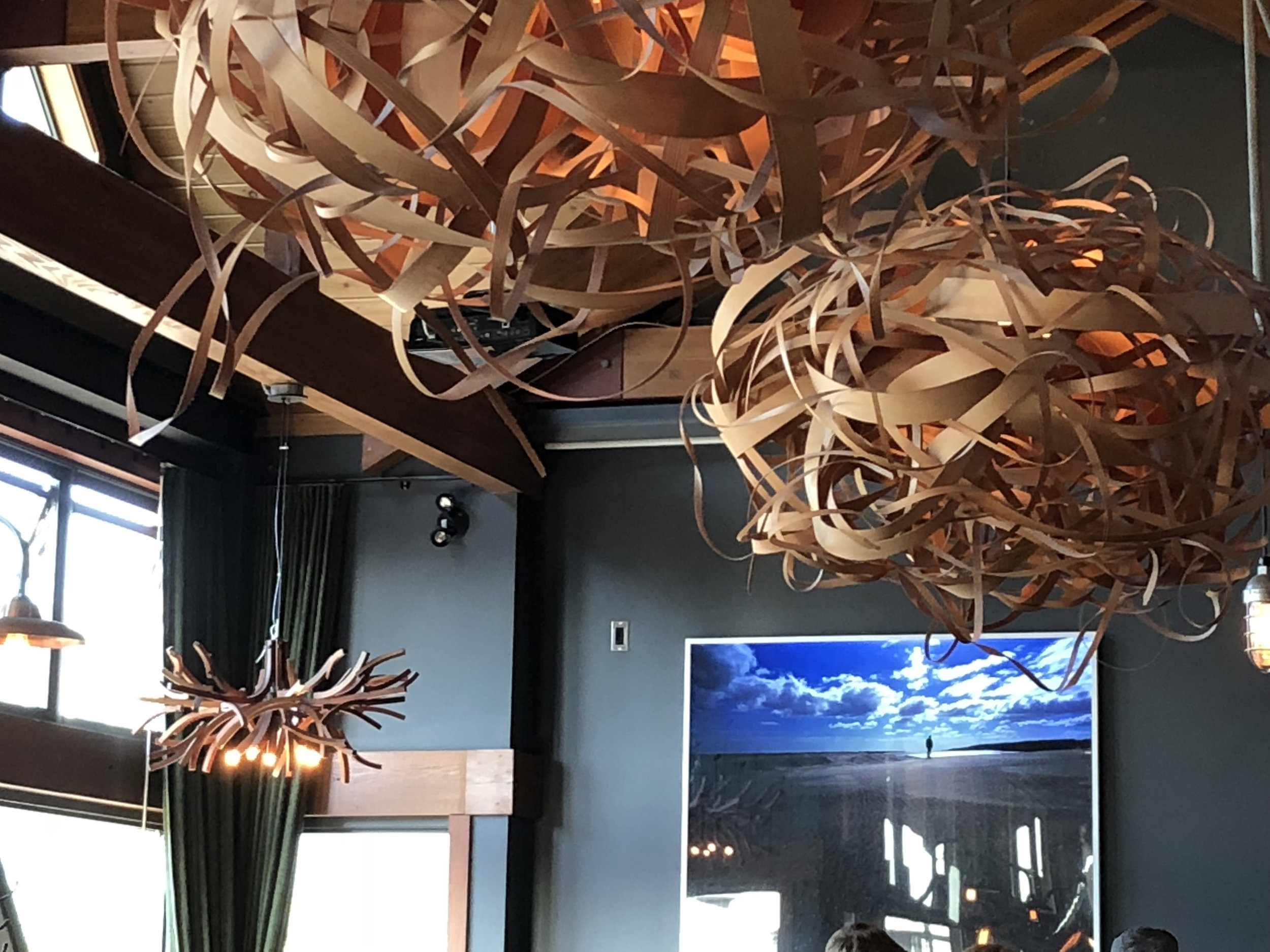 The upstairs dining room at Wolf In The Fog is warm and inviting and features whimsical wood sculptures. There is also a covered, outside patio. If on the rotating menu, try the cheese pierogis, house-made pasta and Salt Spring Island mussels.