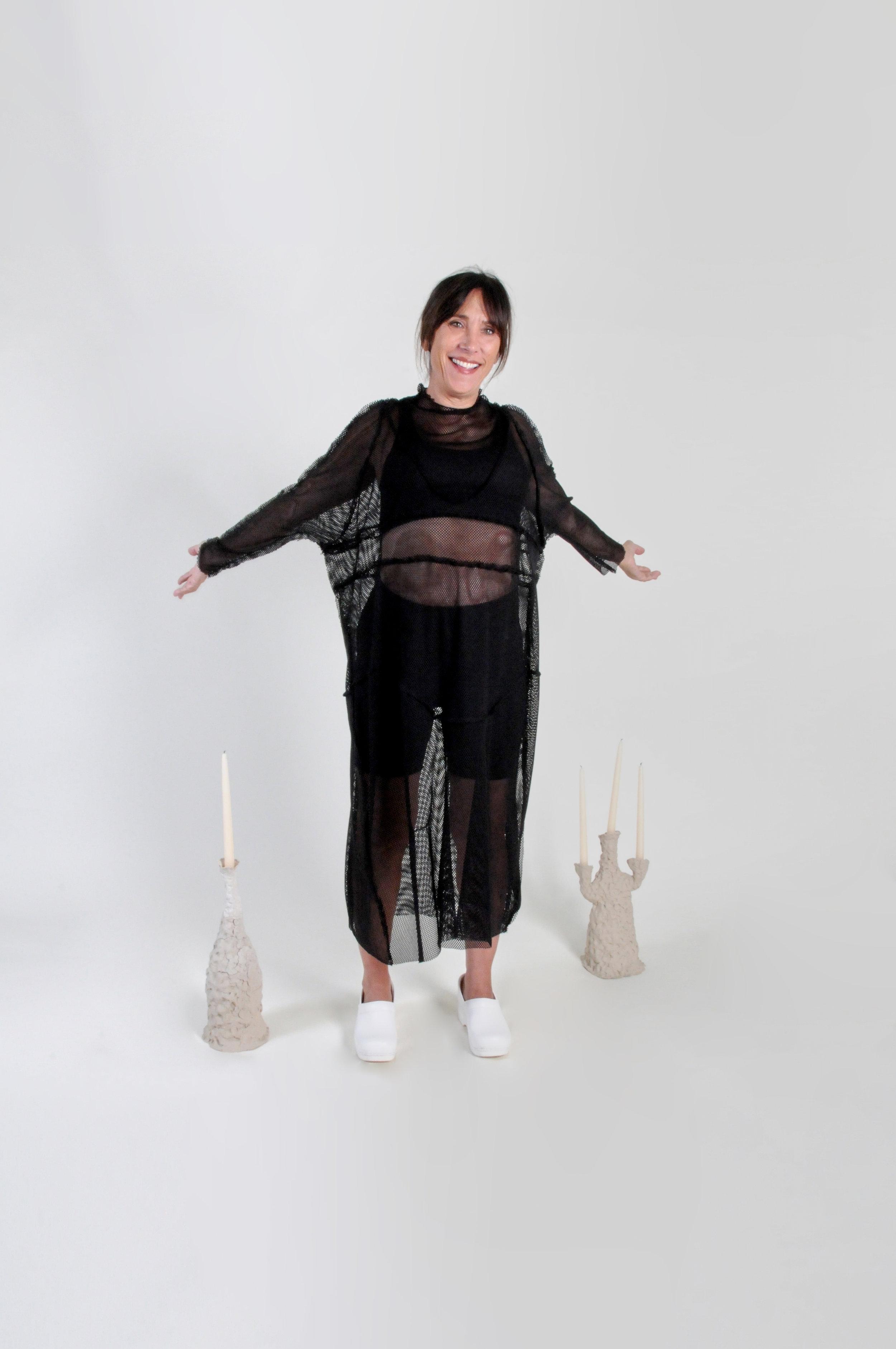 underwear dress: black net - 0216COLOR : BLACKFABRIC : DEADSTOCK STRETCH NETCONTENT: COTTON / POLY / RAYON BLENDWHOLESALE $114 / RETAIL $228SIZES : ONE SIZE / FITS XS - XL