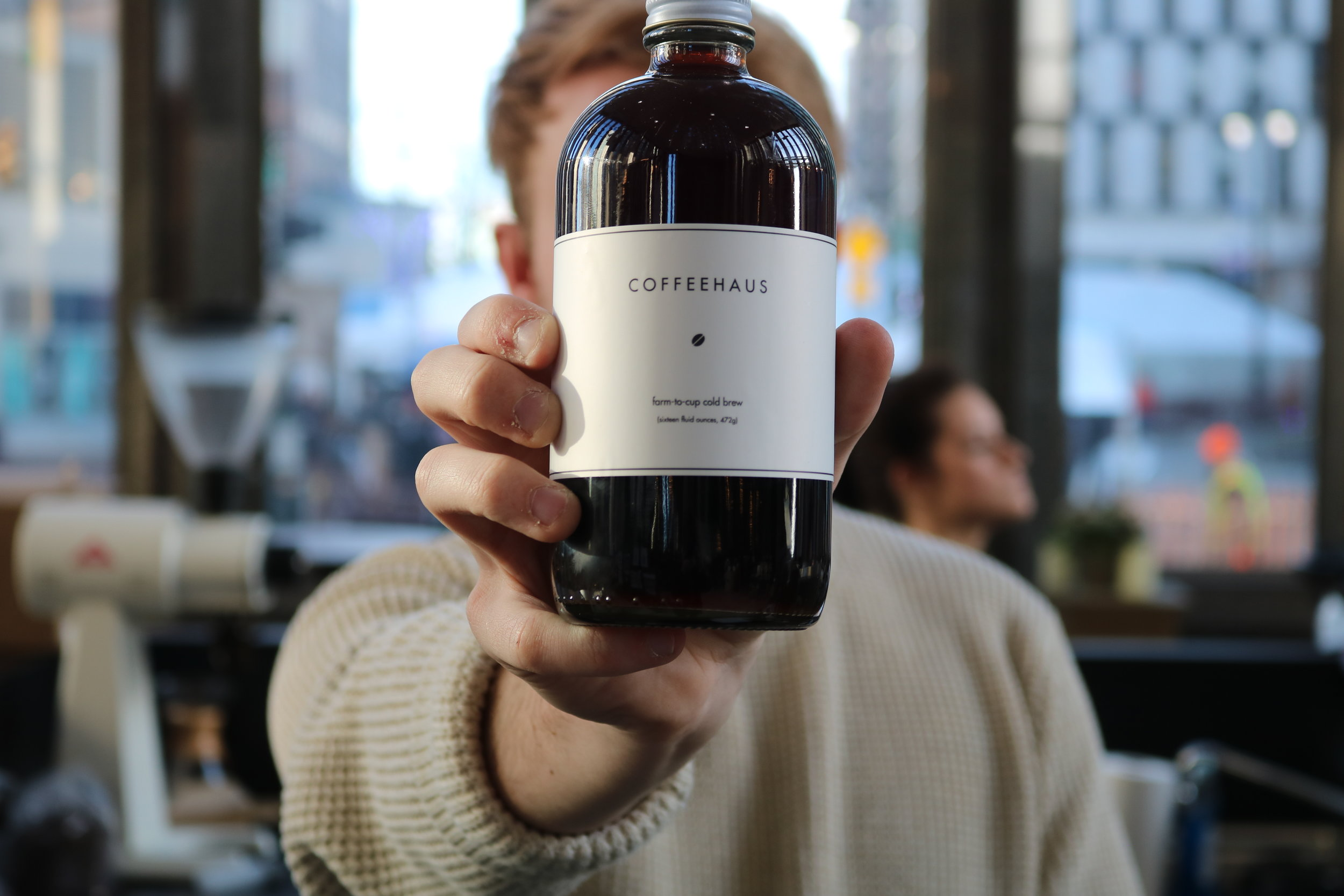 Owner Luke showing off the cold brew bottle.