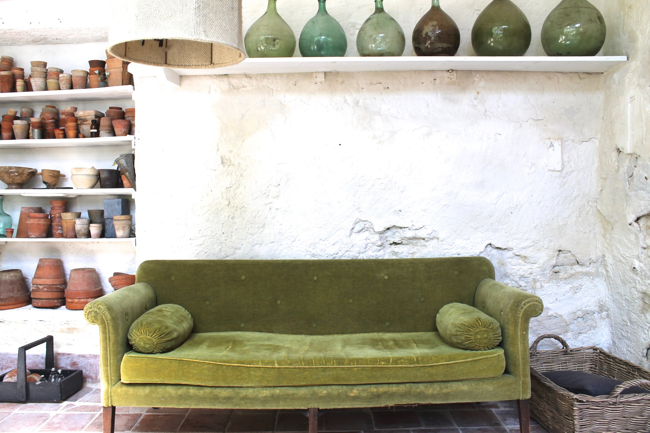 camellas-lloret-maison-d'hotes-greenhouse-green-velvet-couch.jpg