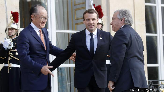French President Emmanuel Macron welcomed world leaders along with World Bank President Jim Young Kim (left) and UN Secretary General Antonio Guterres (right). Picture: Getty Images.