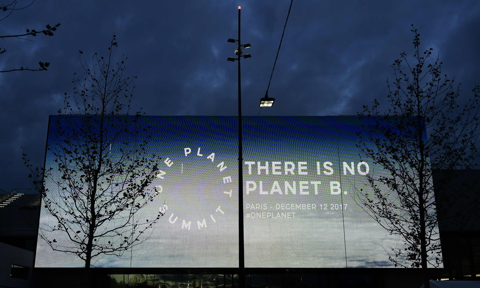 A screen reading 'There is no planet B,' outside the One Planet Summit in Paris. Photograph: Philippe Lopez/AFP/Getty Images.
