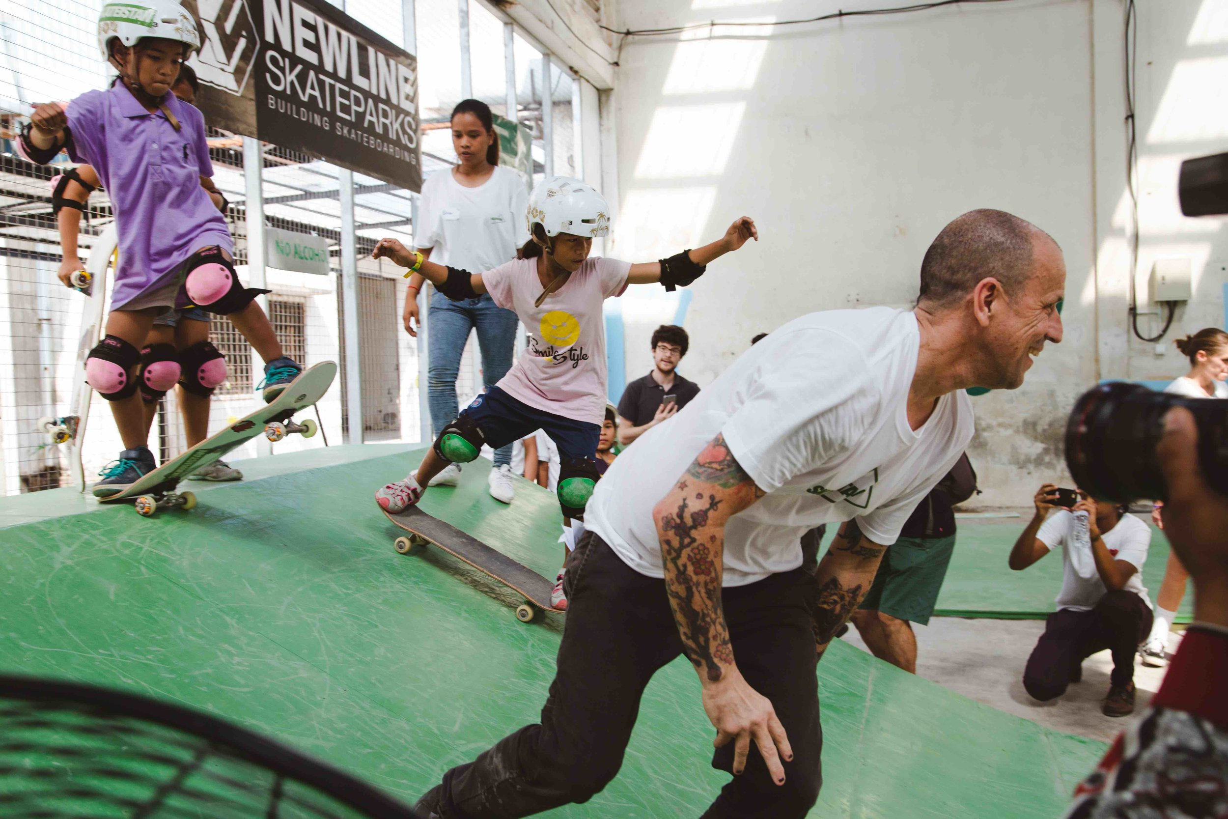 Students and special guest Jim Thiebaud have fun skating together at Skateistan Phnom Penh. Picture: Jeremy Meek