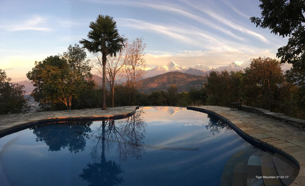 The famous Machhapuchhare Peak is reflected in the retreat's infinity pool.