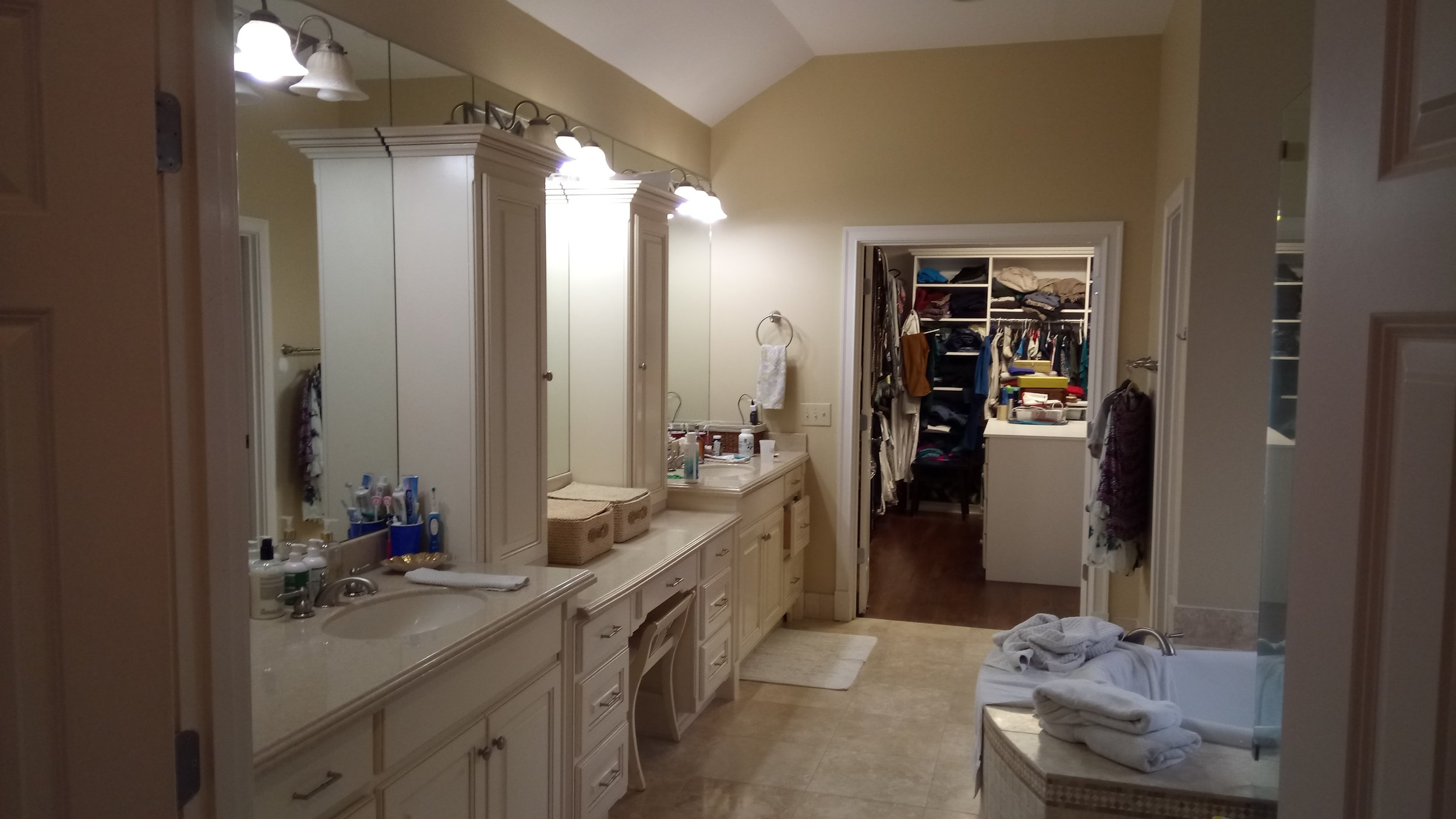 The previous layout had a direct line of sight from the bed, through the bathroom, to a poorly organized closet.