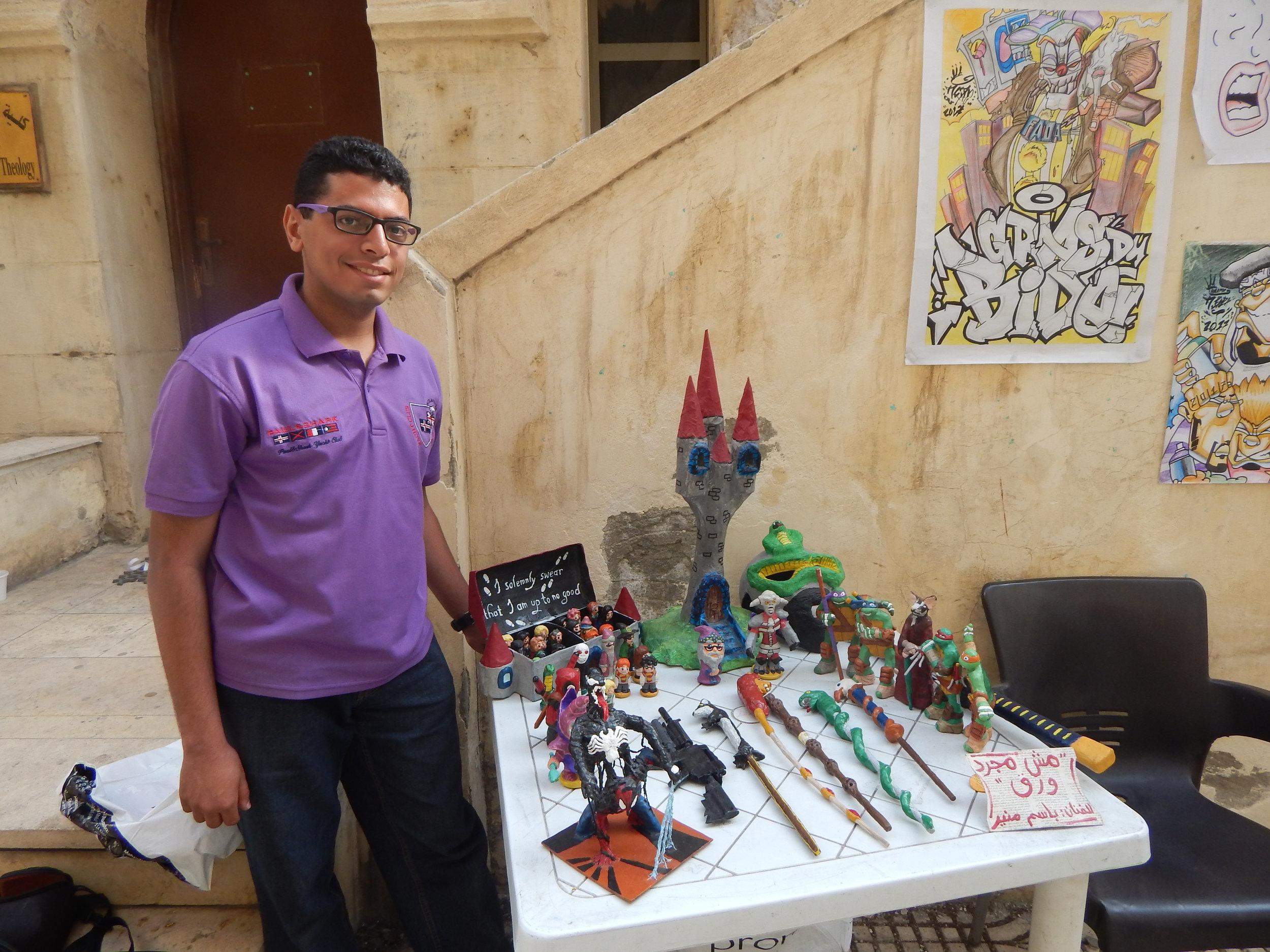 Bassem Mounir with his art display. [Photo by Jayson Casper.]