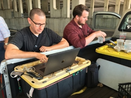Capital Gazette reporter Chase Cook (R) and photographer Joshua McKerrow (L) work on the next day's newspaper while awaiting news from their colleagues in Annapolis, Maryland (AFP/Getty Images)
