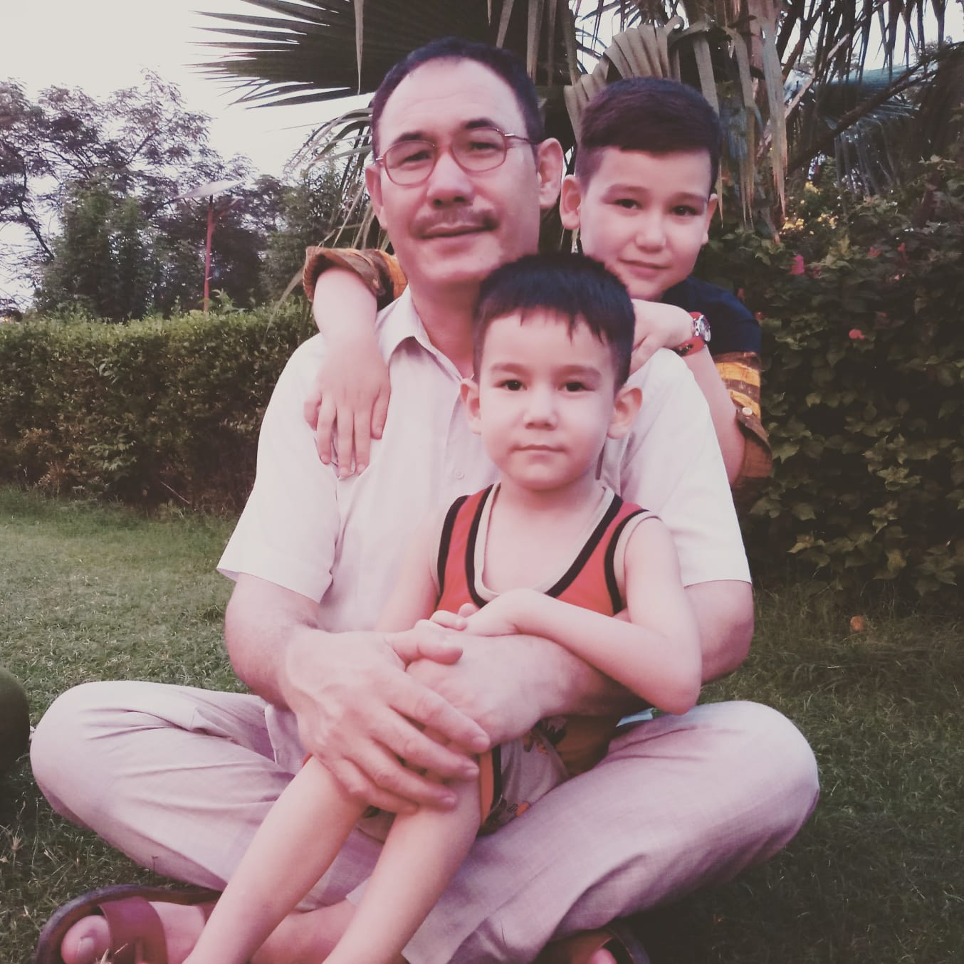 Abdul with two of his grandsons, Aziza's sons.