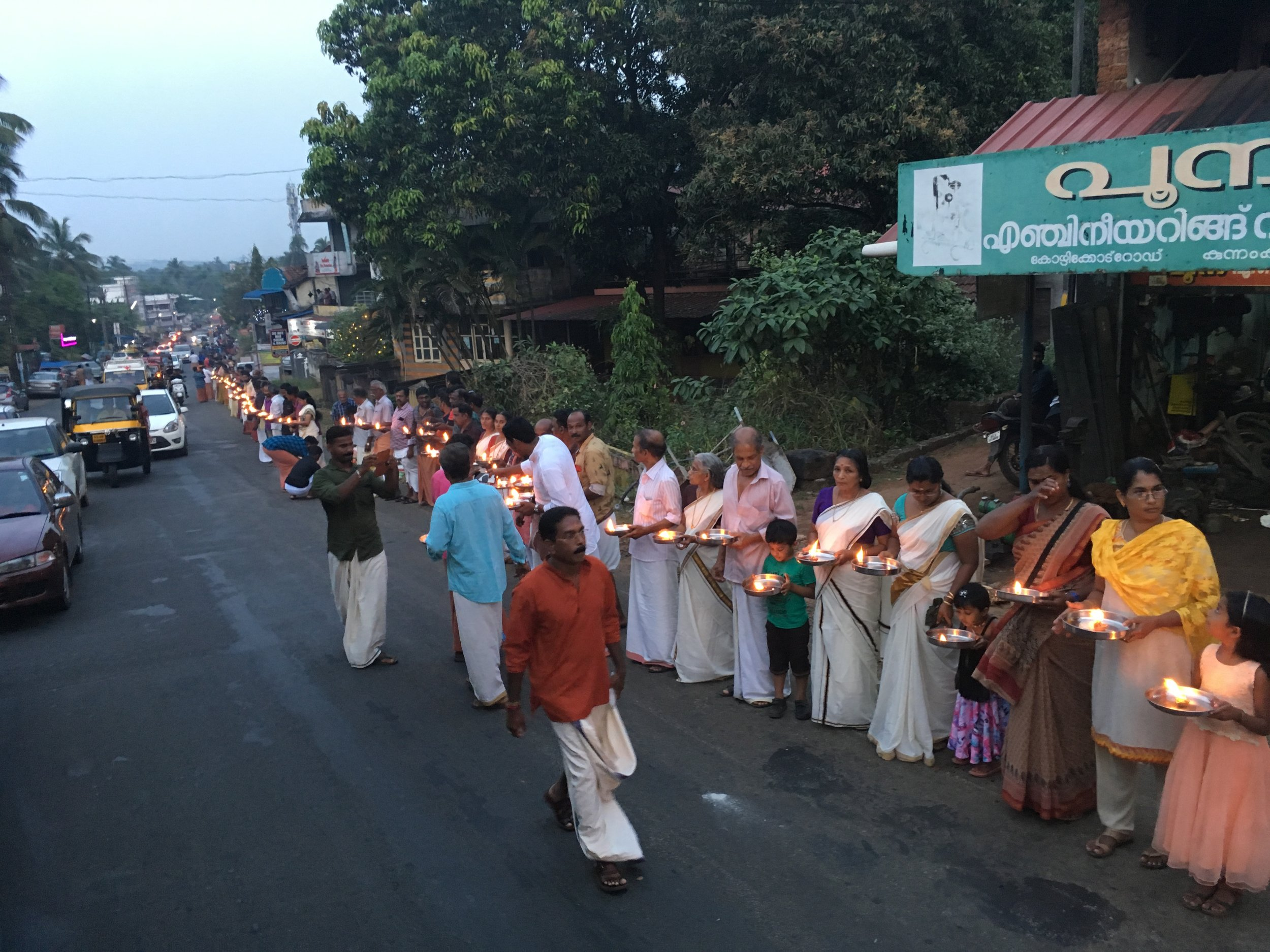 On Dec. 26, Ayyappa devotees in Kerala lit candles along a major state highway to protest a Supreme Court order that allows women to enter their god's shrine. Photo by Meagan Clark.