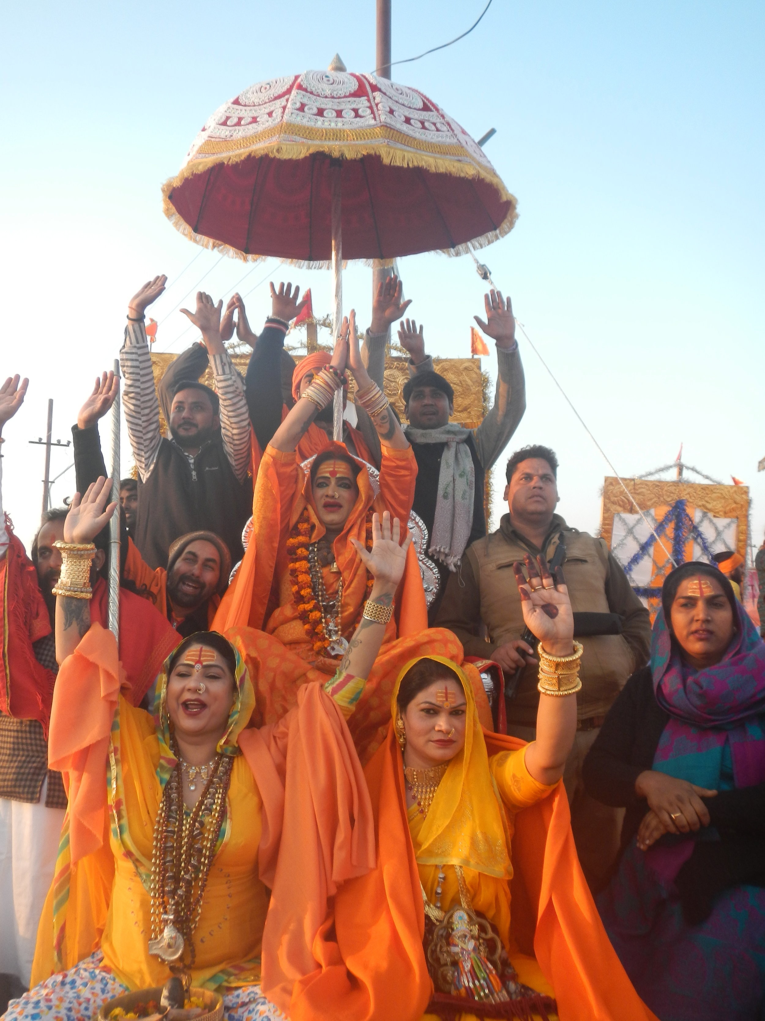Laxmi Narayan Tripathi (center) along with other transgender seers participate in a religious procession ahead of ceremonial bathing in Prayagraj, India. Photo by Priyadarshini Sen.
