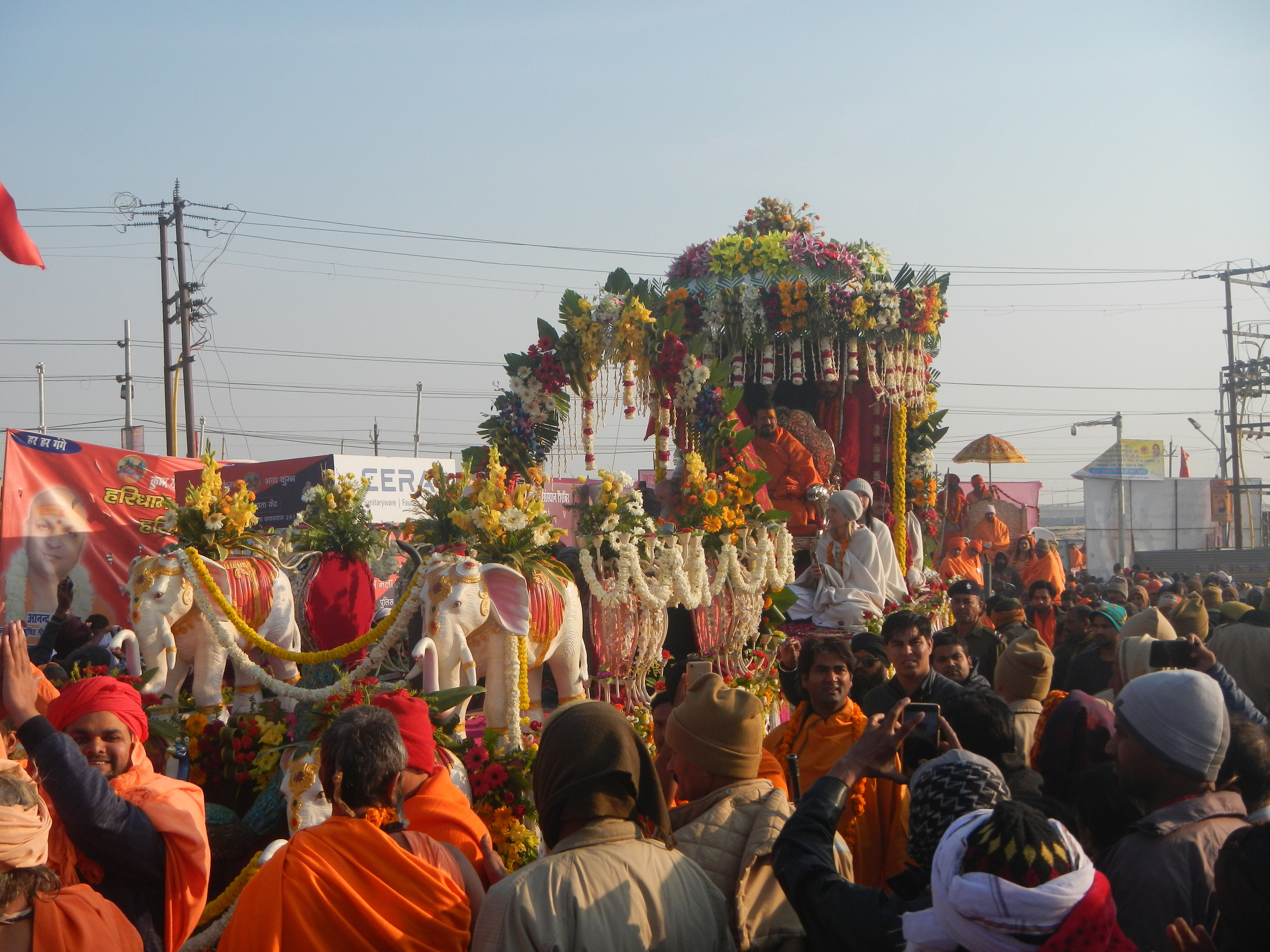 Traditional seers participate in a religious procession ahead of ceremonial bathing in Prayagraj, India. Photo by Priyadarshini Sen.