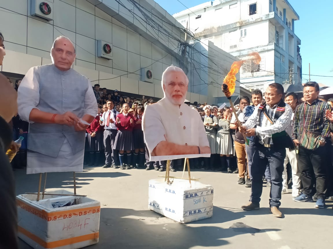 A protester in Guwahati, Assam, India prepares to set fire to a cardboard cut-out of Indian Prime Minister Narendra Modi. Modi's political party also heads the state government of Assam. Photo by Shuriah Niazi.