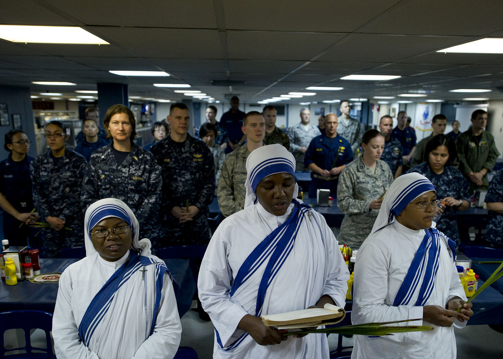 Nuns of the Missionaries of Charity from Jamaica sing hymns during a church service aboard a US military hospital ship in 2011. Photo by Jonathen E. Davis, US Navy.