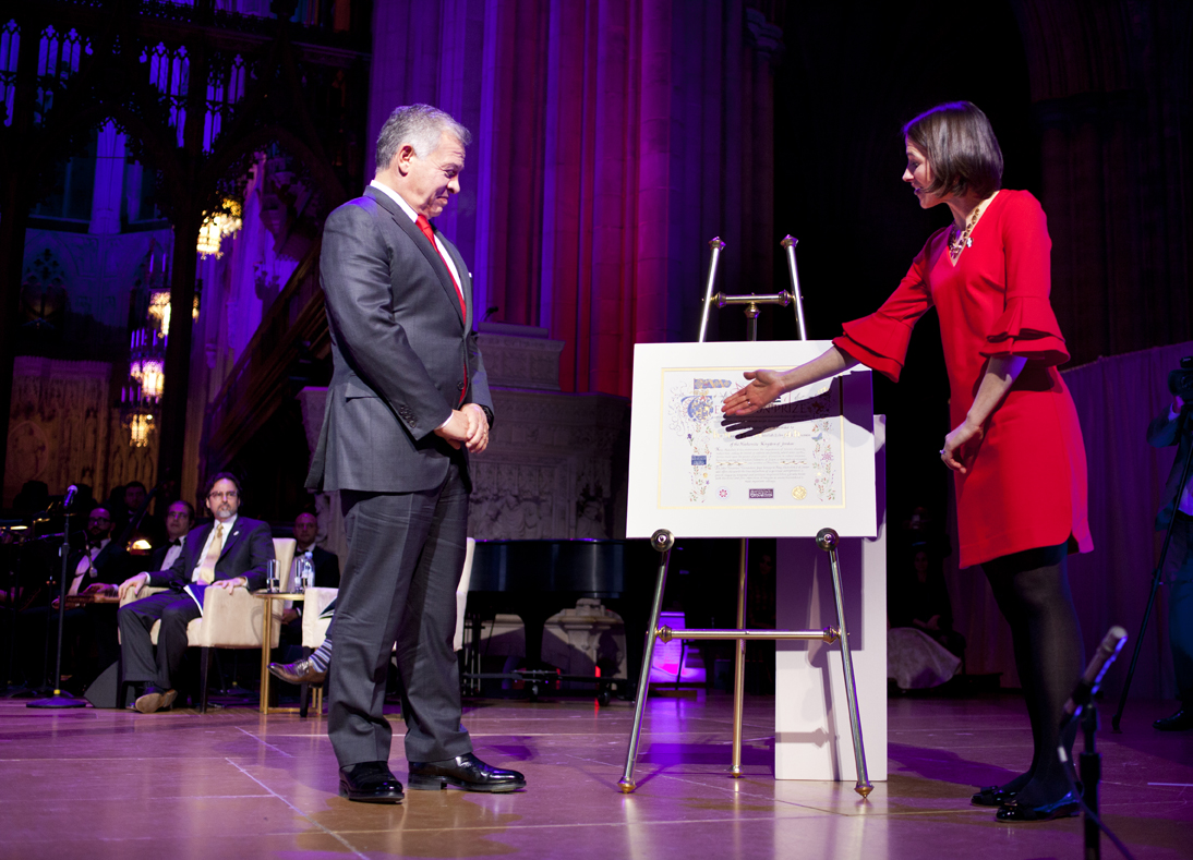 "Heather Templeton Dill, president of the John Templeton Foundation, presents the Templeton Prize ""Tree of Life"" medallion to His Majesty King Abdullah II of Jordan, at the Templeton Prize Ceremony, Washington National Cathedral, November 13, 2018. (Photo credit: Templeton Prize-Clifford Shirley)"