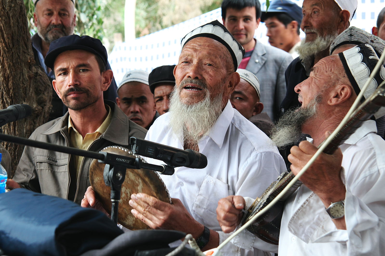 Chinese Uighur Muslim musicians performing for Meshrep, a traditional entertainment of singing and dancing, in Yarkand County, Xinjiang Uyghur Autonomous Region, China. Photo by  Traveling Mipo .