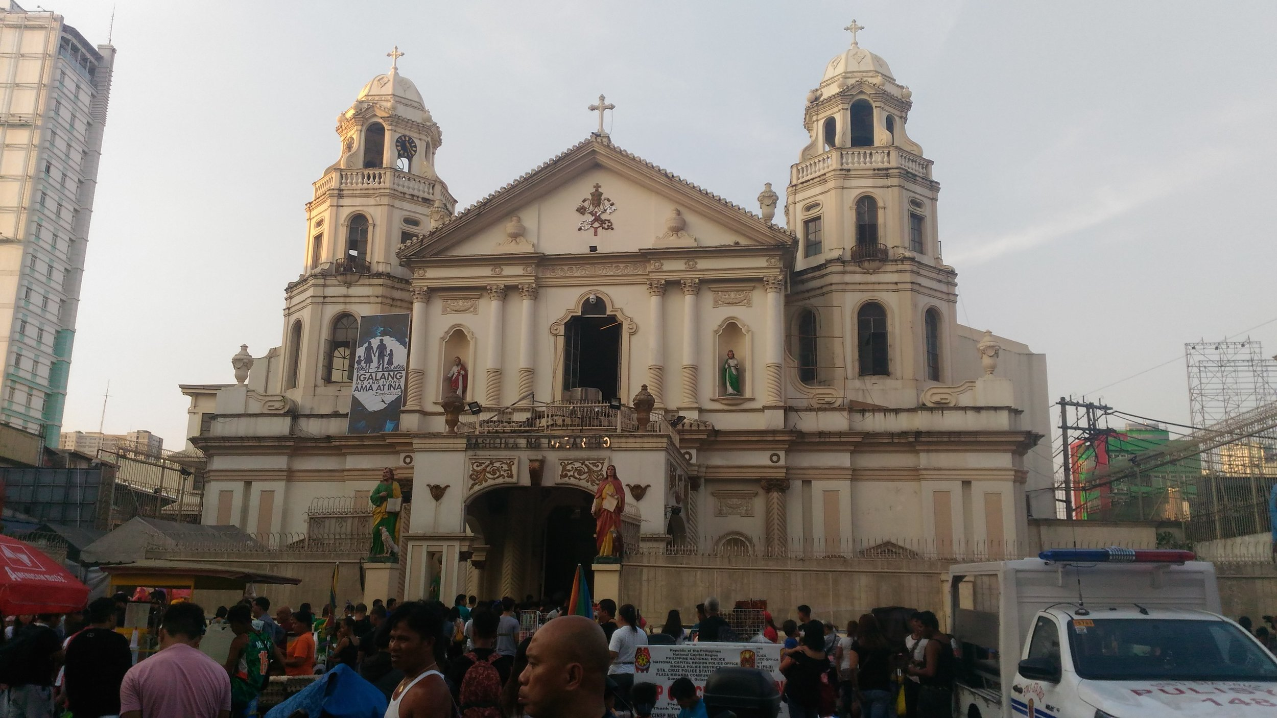"""This """"Quiapo Church"""" is the most densely-populated in the country, especially on Fridays and Sundays due to the presence of the Black Nazarene, paraded on Jan. 9 every year by hundreds of thousands of the penitent, despite some injuries and even death. The Church also carried a banner for months which read """"Huwag kang Papatay,"""" or """"Thou shalt not kill,"""" after the mounting number of killings by police in the bloody drug war. Photo by Baby Lyn Cacho Resulta."""