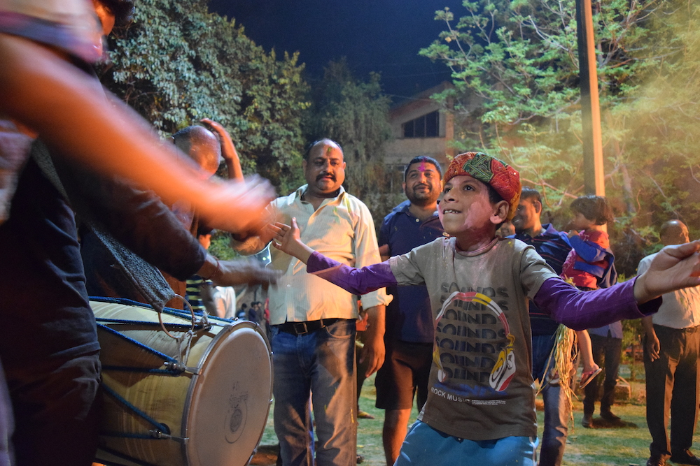 A boy dances to drum beats during Holika Dahan, an annual evening Hindu ceremony to pray away evil and welcome the new year and springtime. Photo by Meagan Clark.