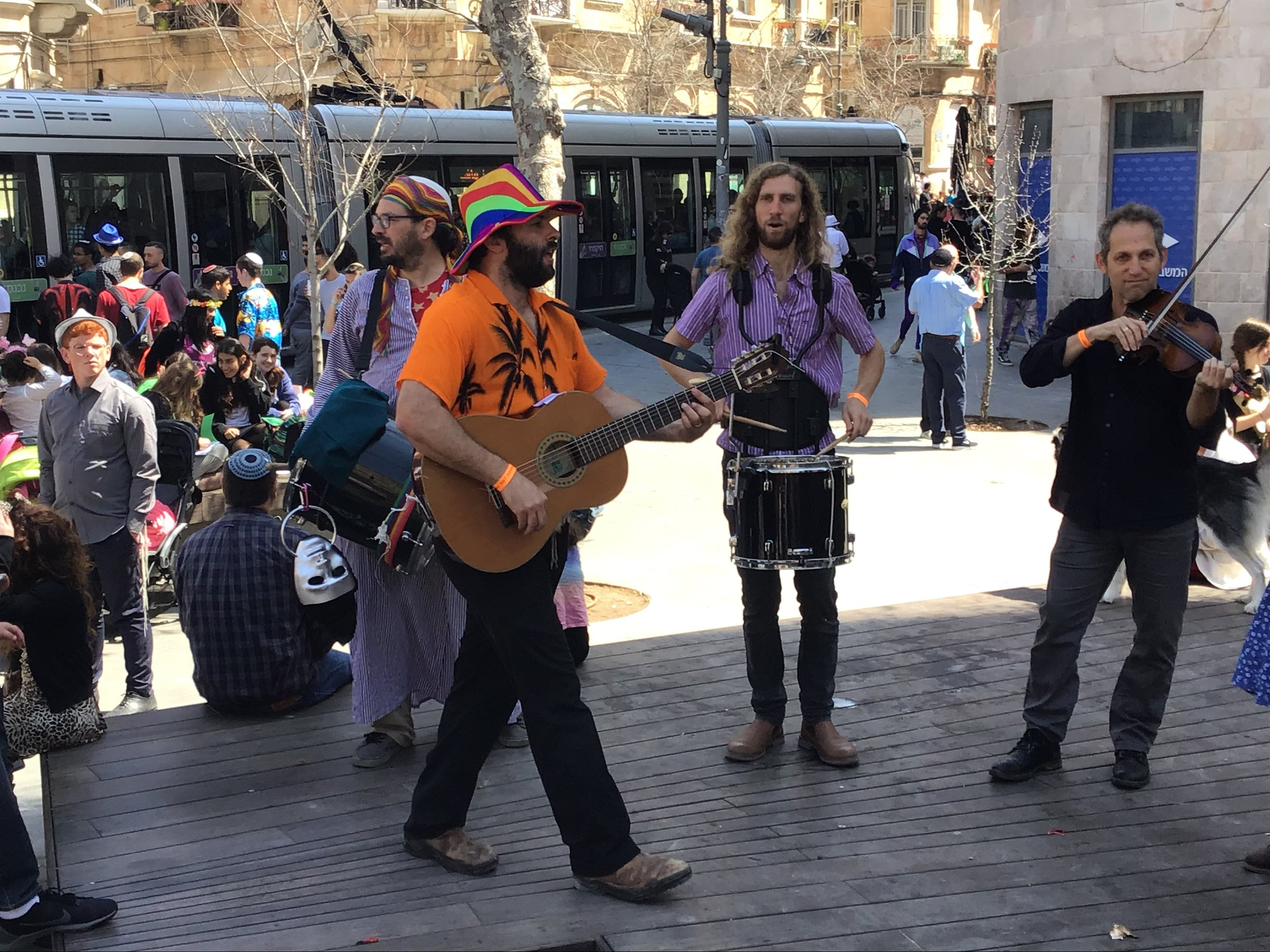 A band plays music in Jerusalem for the holiday Purim. Photo by Gil Zohar.