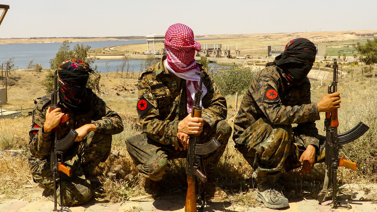 IRPGF fighters, an anarchist communist collective fighting ISIS and considered a terrorist organization, in Tabqa during the Syrian civil war in 2017.  The group dissolved in 2018. Photo via  Creative Commons .