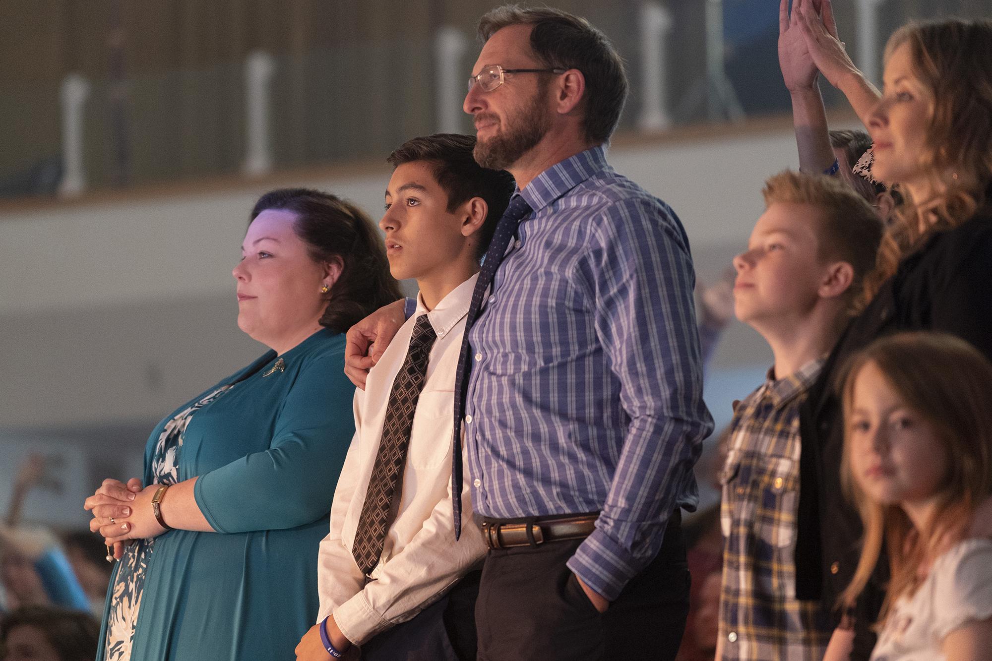 "Chrissy Metz (Joyce Smith), Marcel Ruiz (John Smith), and Josh Lucas (Brian Smith), shown in a scene at church, star in 20th Century Fox's ""Breakthrough."" Photo by Allen Fraser."