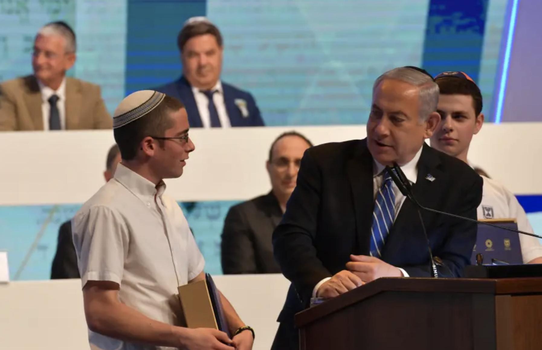 Yonatan Weissman with Prime Minister Benjamin Netanyahu after he won the International Bible Contest on May 9, 2019. Photo by Kobi Gideon/GPO.