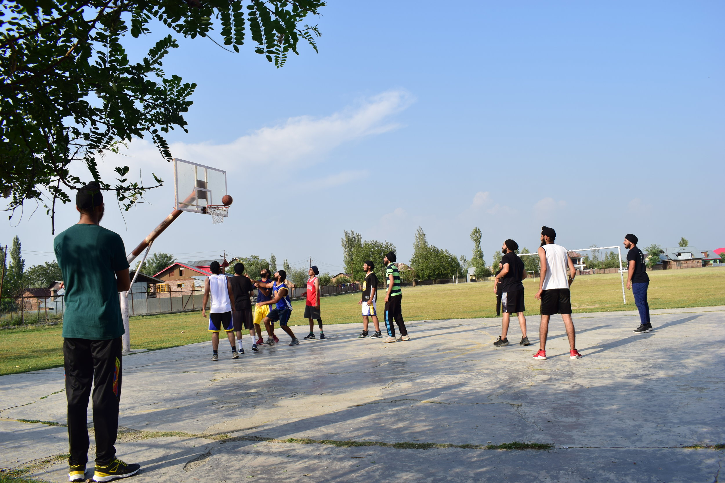 Sikh students play basketball at Kashmir University in Srinagar, the state capital. Sikhs are advocating for a Punjabi department at Kashmir University, a special government job package for Kashmiri Sikhs and democratic representation they feel shut out of. Photo by Karanjeet Singh.