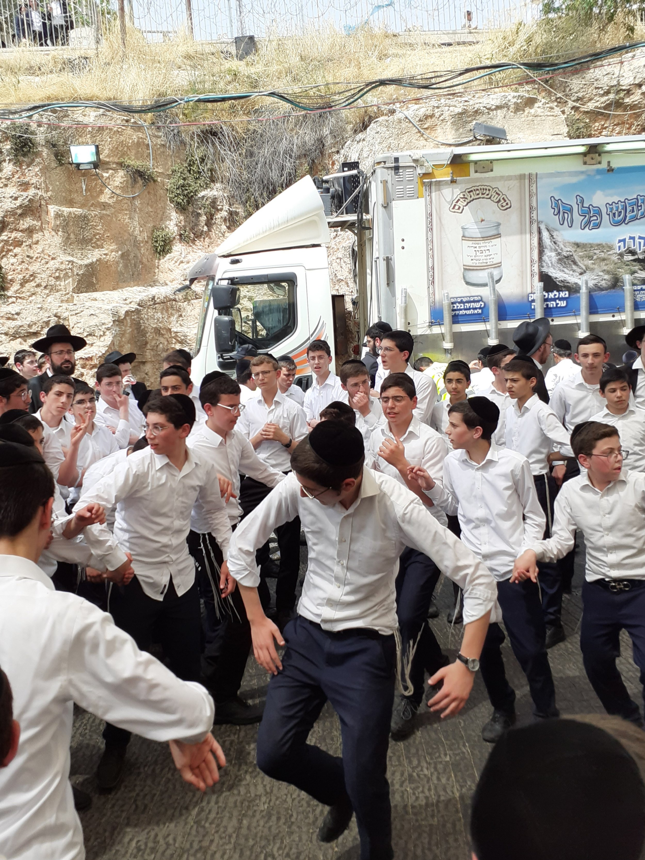 Some boys dance while on pilgrimage.