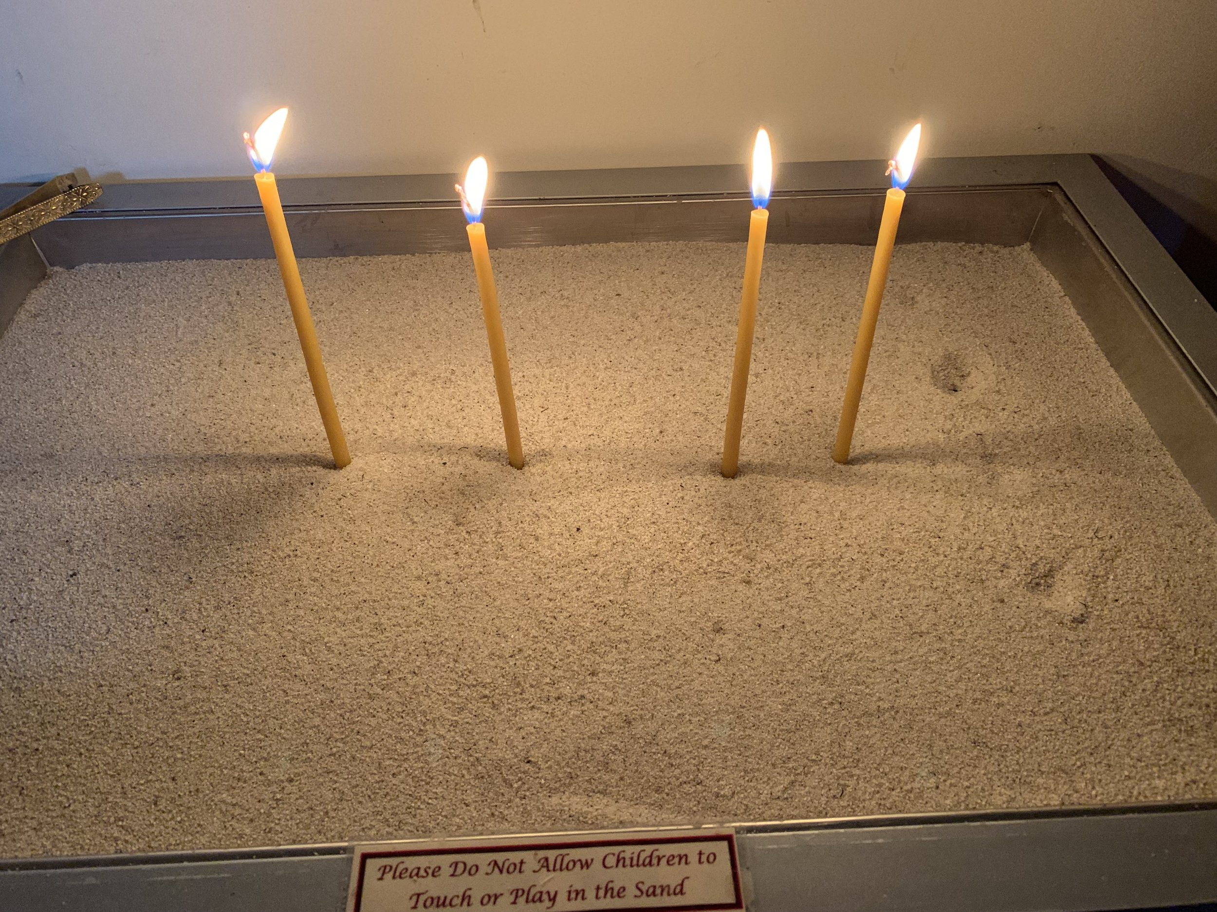 Candles contribute to the ambience inside the church. Photo by Julia Duin.