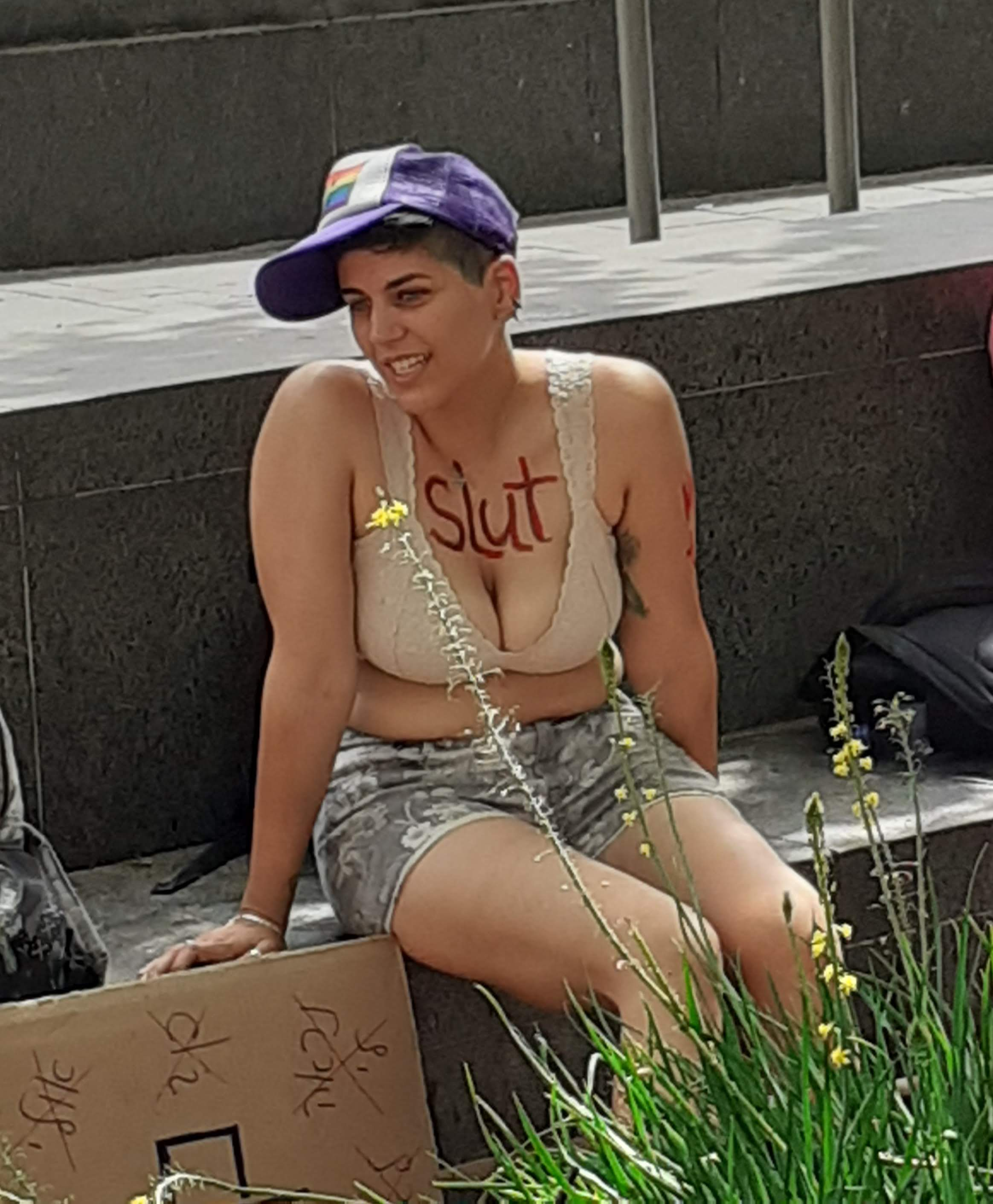 A woman attending the Slutwalk march in May. Some women removed their shirts in protest of religious leaders and victim-blaming women who come forward with sexual abuse and rape allegations. Photo by Gil Zohar.