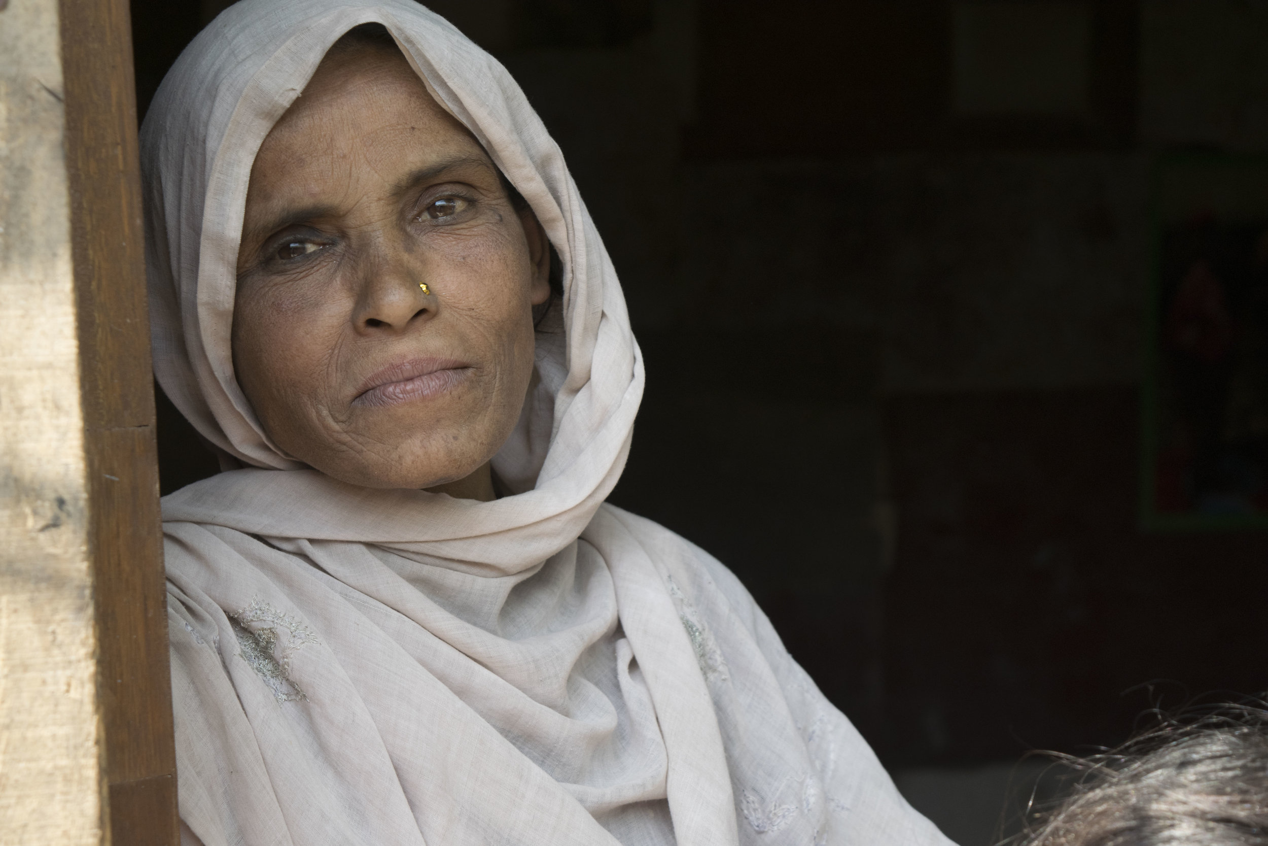 A Rohingya woman living in a refugee camp in Delhi, India. The camps have poor living conditions, with no access to running water. Photo by Meagan Clark.