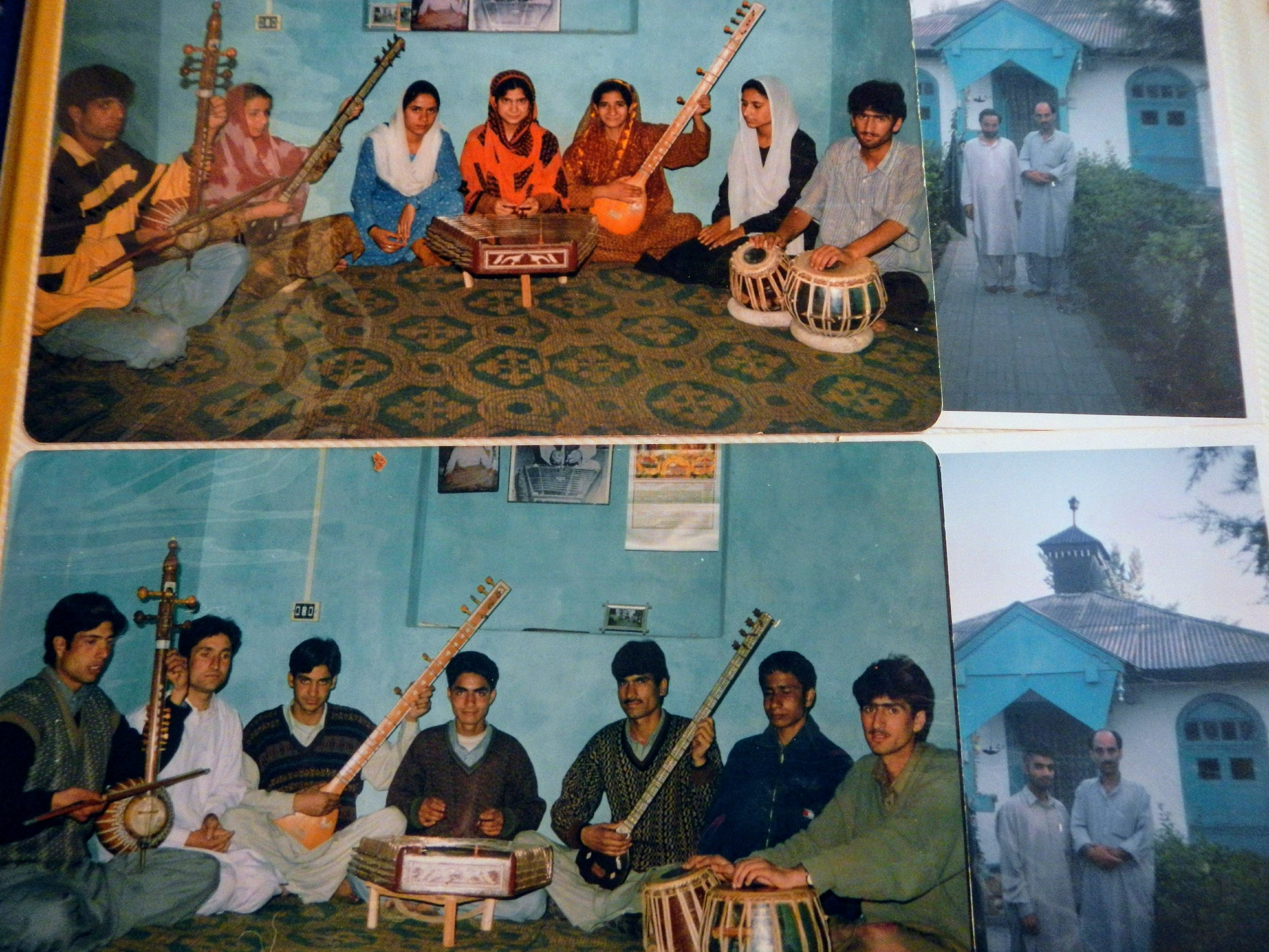 A photo album with students—girls and boys—who trained with Ustad Mohammad Yaqoob Sheikh in Kashmiri classical music in Srinagar, India. Photo by Priyadarshini Sen.
