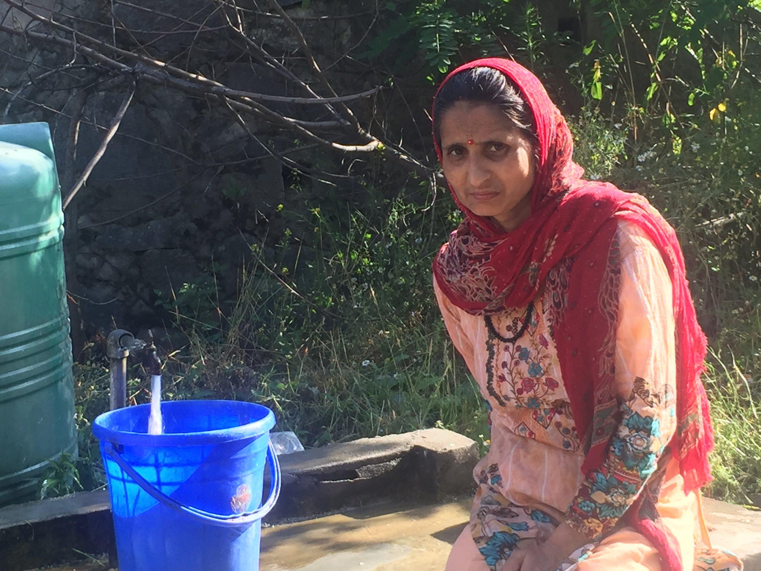 A Kashmiri Hindu woman collecting tap water in Kashmiri Pandit colony at Budgam, Kashmir. Photo by Taha Zahoor.