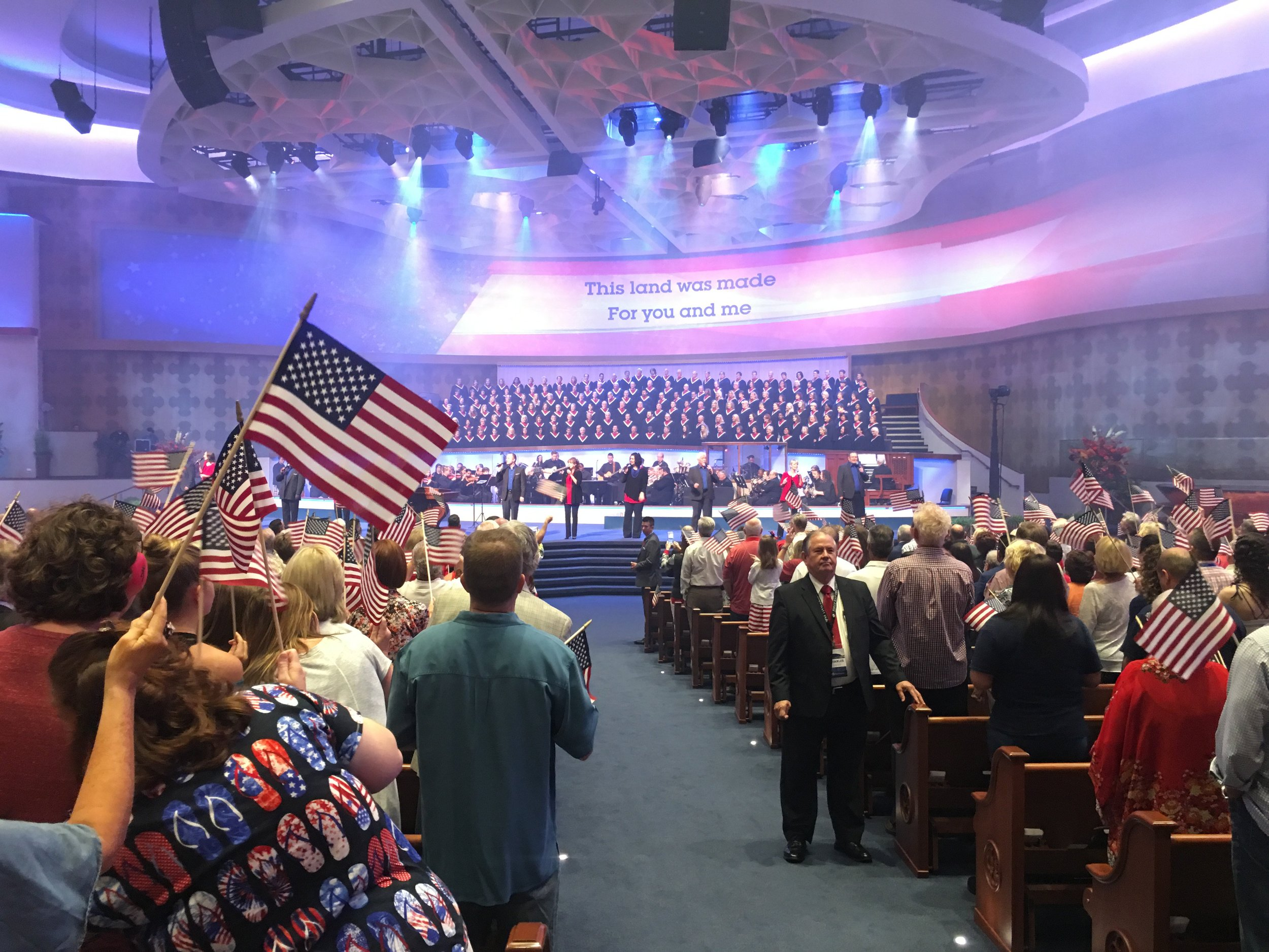 "The congregation of First Baptist Dallas during a special Freedom Sunday service June 25, 2017. Part of the service involves saluting each branch of the armed forces, and guests to the church receive free copies of messages titled ""America at the Crossroads"" and ""America is a Christian Nation."" Photo posted by Dr. Robert Jeffress on  Twitter ."