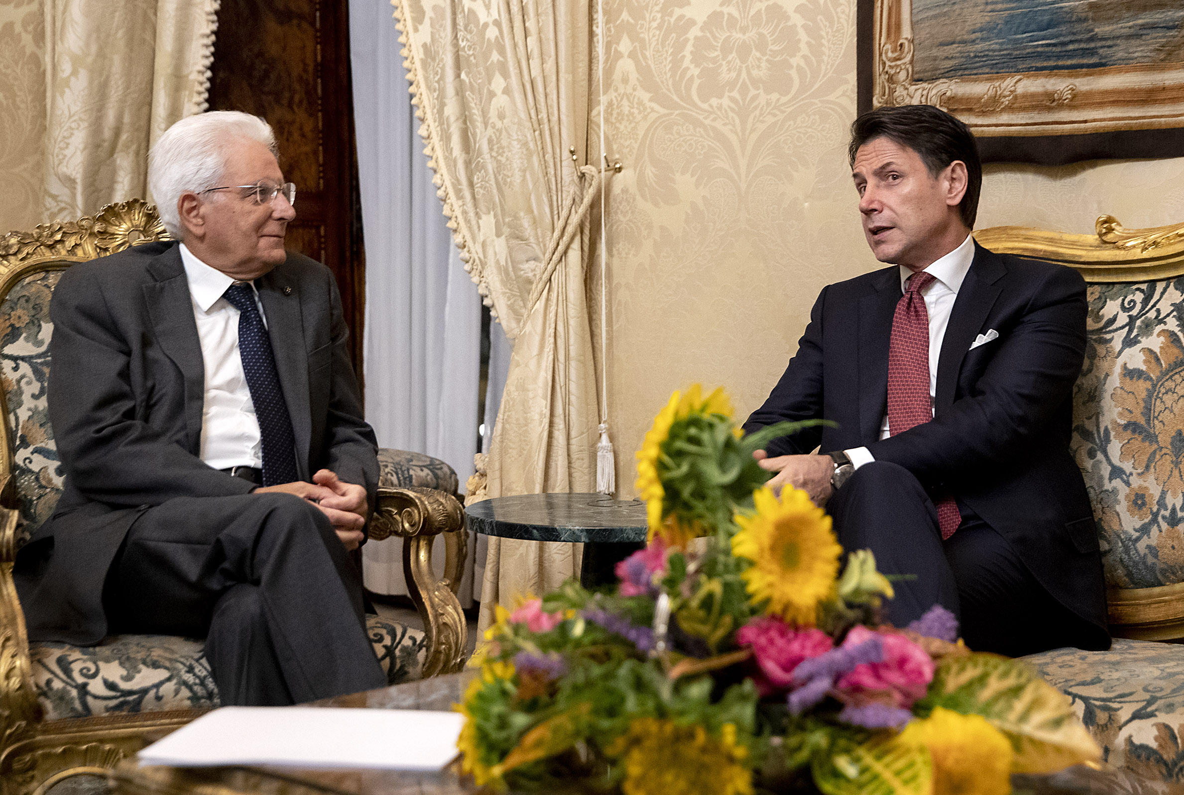 Outgoing Prime Minister Giuseppe Conte (right) tenders his resignation during a meeting with Italy's President Sergio Mattarella this past Tuesday in Rome. (Photo credit: Presidenza della Repubblica)