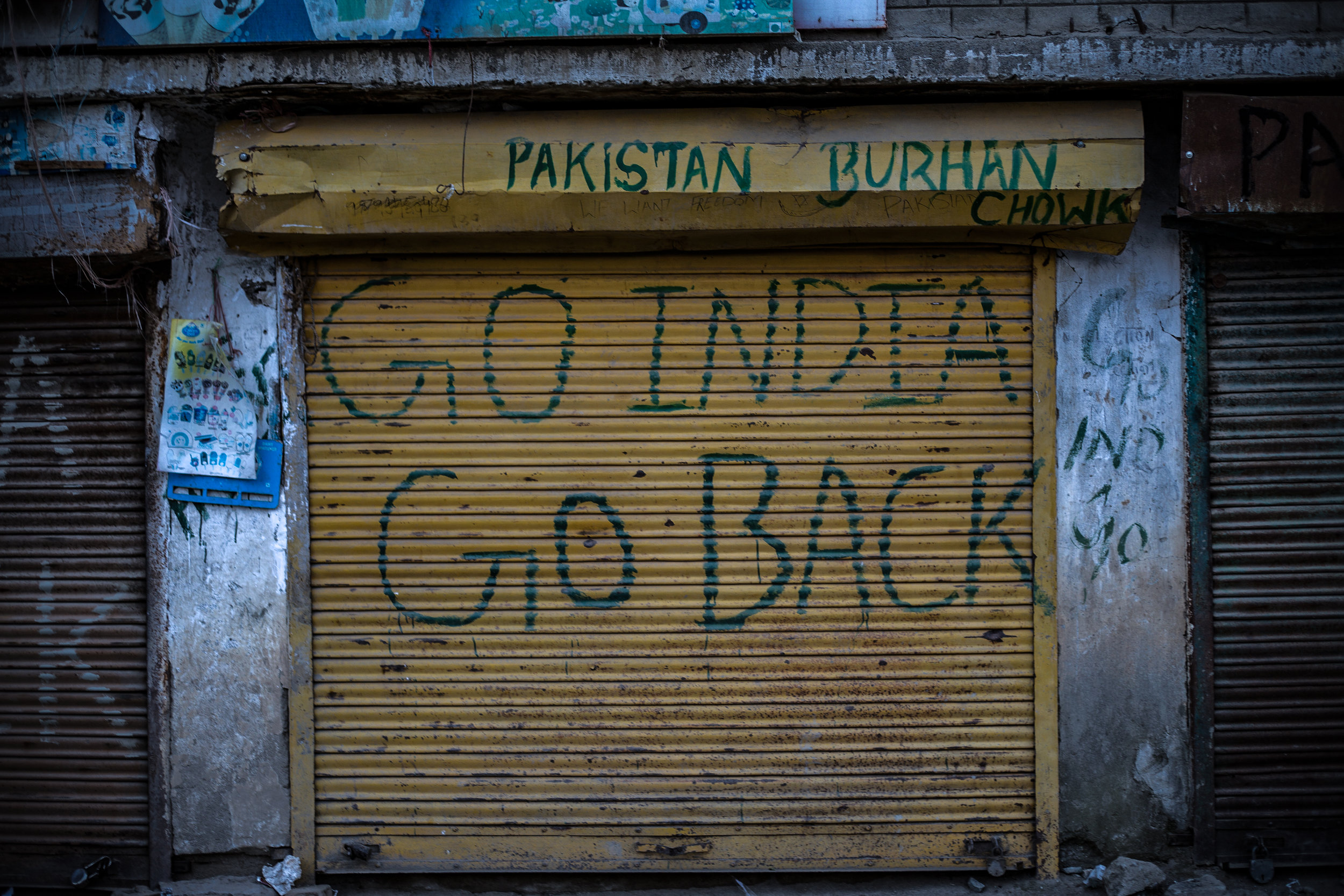 The anti-India sentiment is visible in the area. Various slogans denouncing India, and praising Pakistan, can be seen on the gates of the shops – which the people have closed to mark their protest against the Indian government unilateral decision of stripping Kashmir's autonomy and statehood. Photo by Avinash Giri.