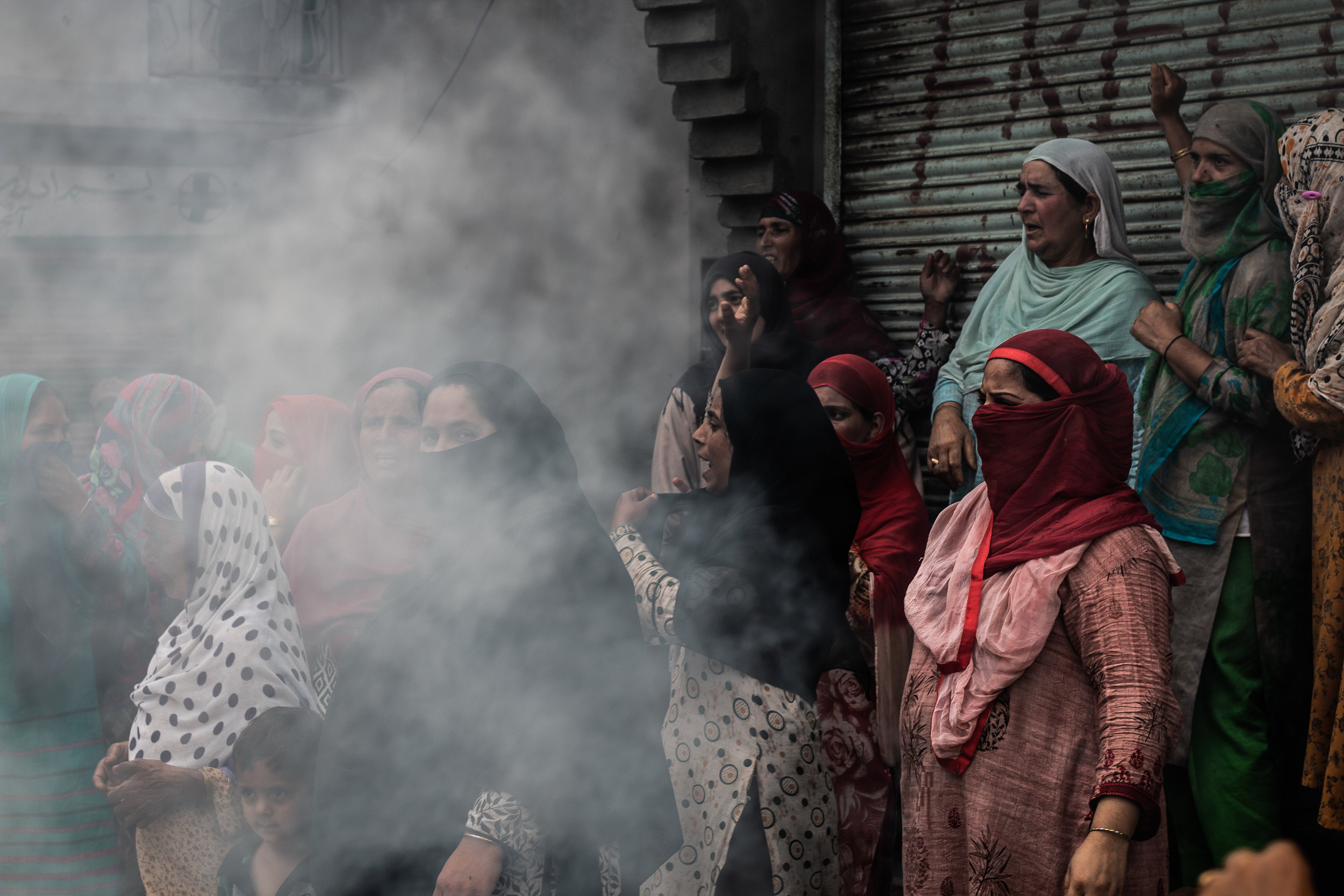 Though the forces used tear gas and chili grenades, women, alongside men, stood their ground. Many struggled to breathe normally after coming in contact with the shells. Photo by Avinash Giri.