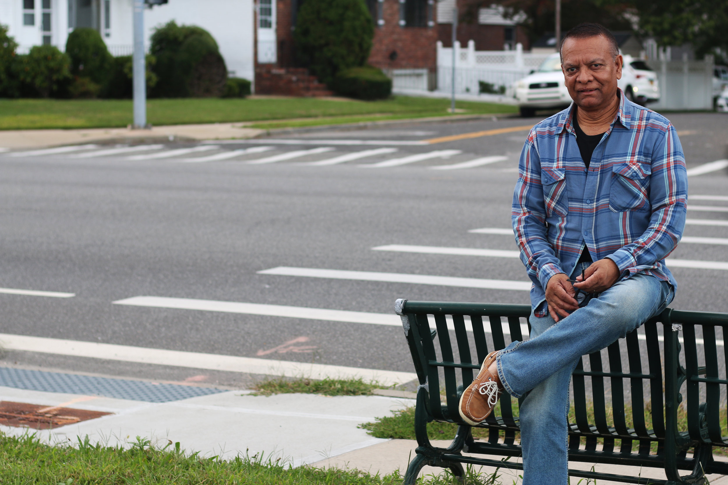 Stanley Praimnath sits in Elmont, N.Y, the Long Island town where he lived in 2001. Photo by Micah Danney.