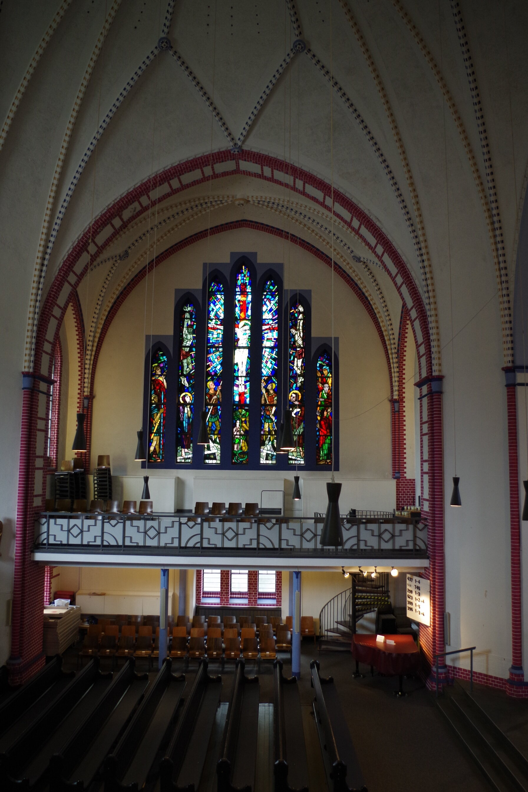 The stained glass of Hamburg's Kreuzkirche (Holy Cross Church) depicts Jesus on the cross. Photo by Jelena Malkowski.