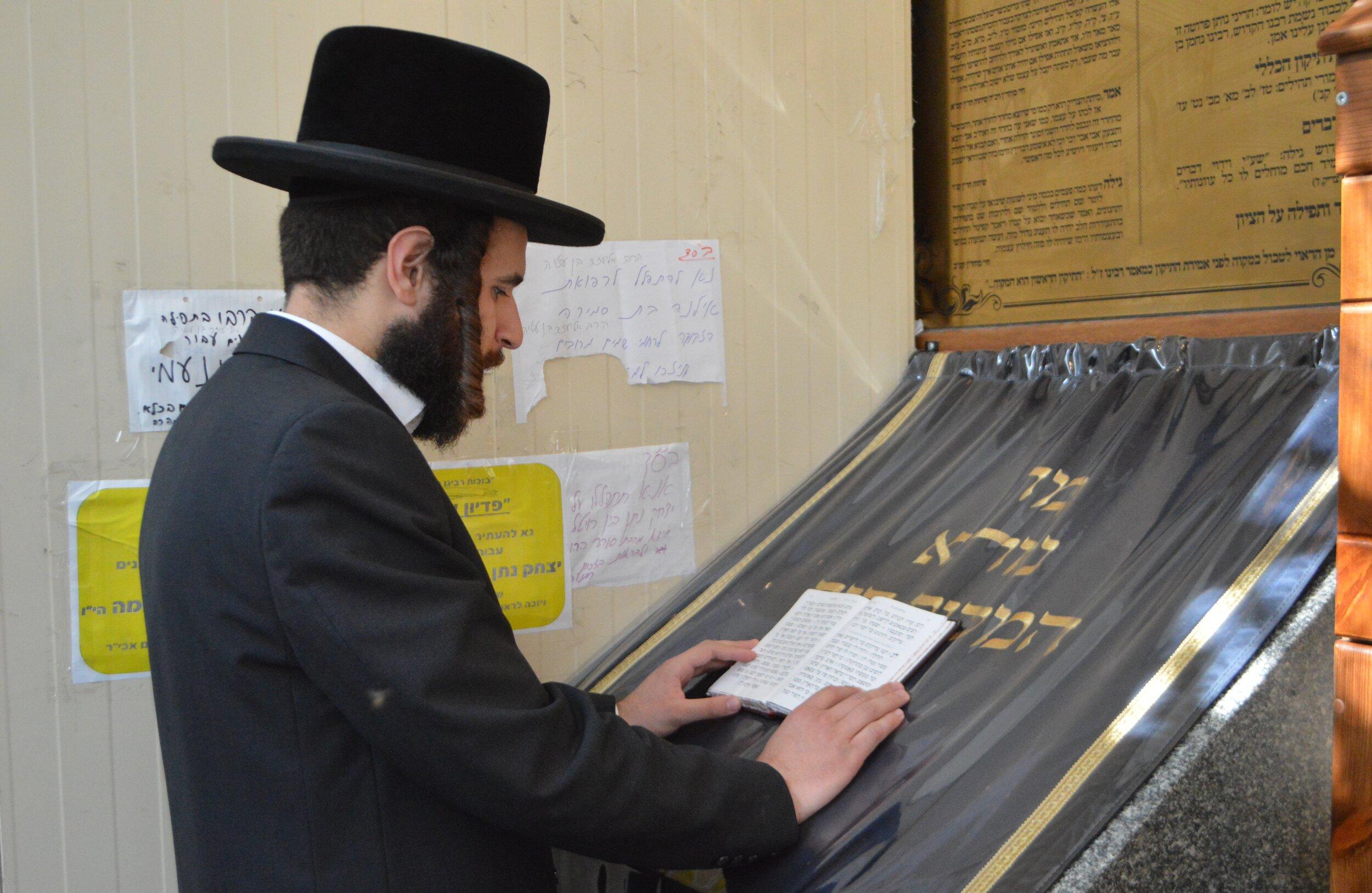 Josef Chaim prays at the site of Rabbi Nachman's grave in Uman, Ukraine. Photo by Paul Brian.