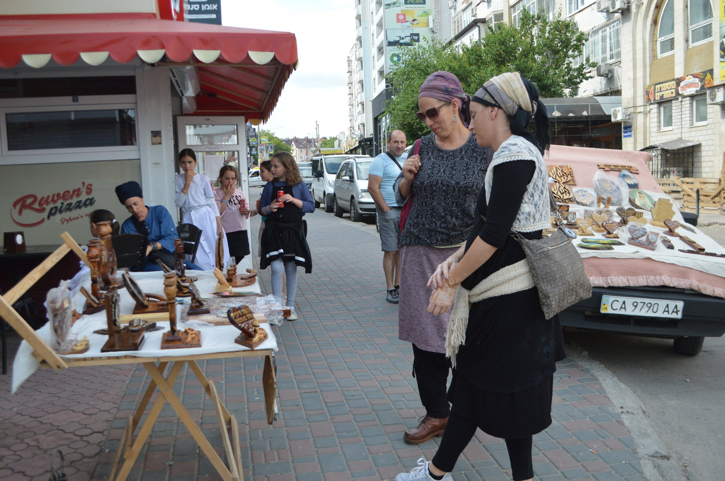 Breslov Hasidic women check out Judaica and souvenirs on Pushkina St. in Uman, Ukraine. Photo by Paul Brian.