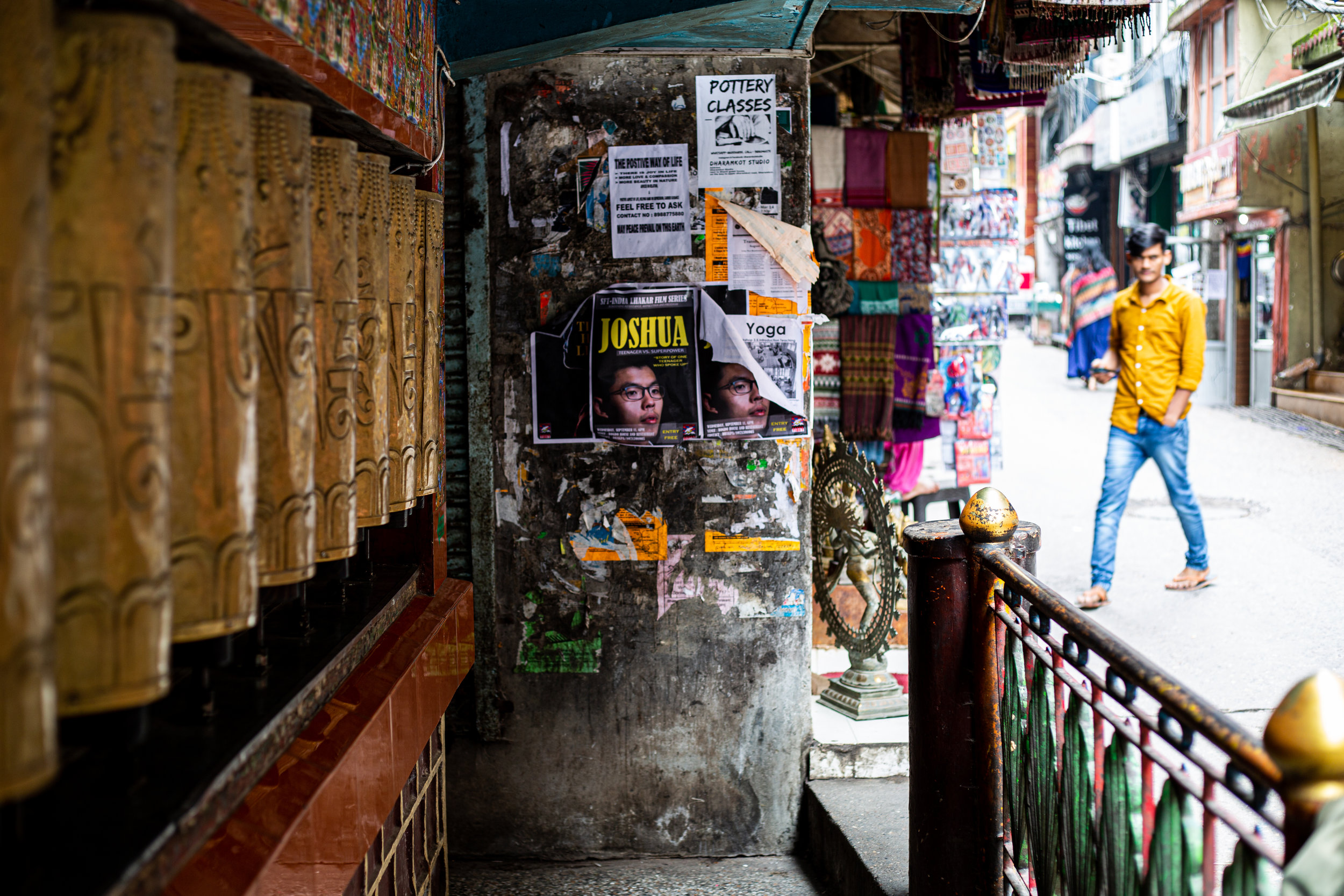 Posters of Joshua Wong, one of the leading pro-democracy leaders in Hong Kong, were pasted over many walls in the streets of Dharamshala, the largest Tibetan settlement in India. Photo by Avinash Giri.