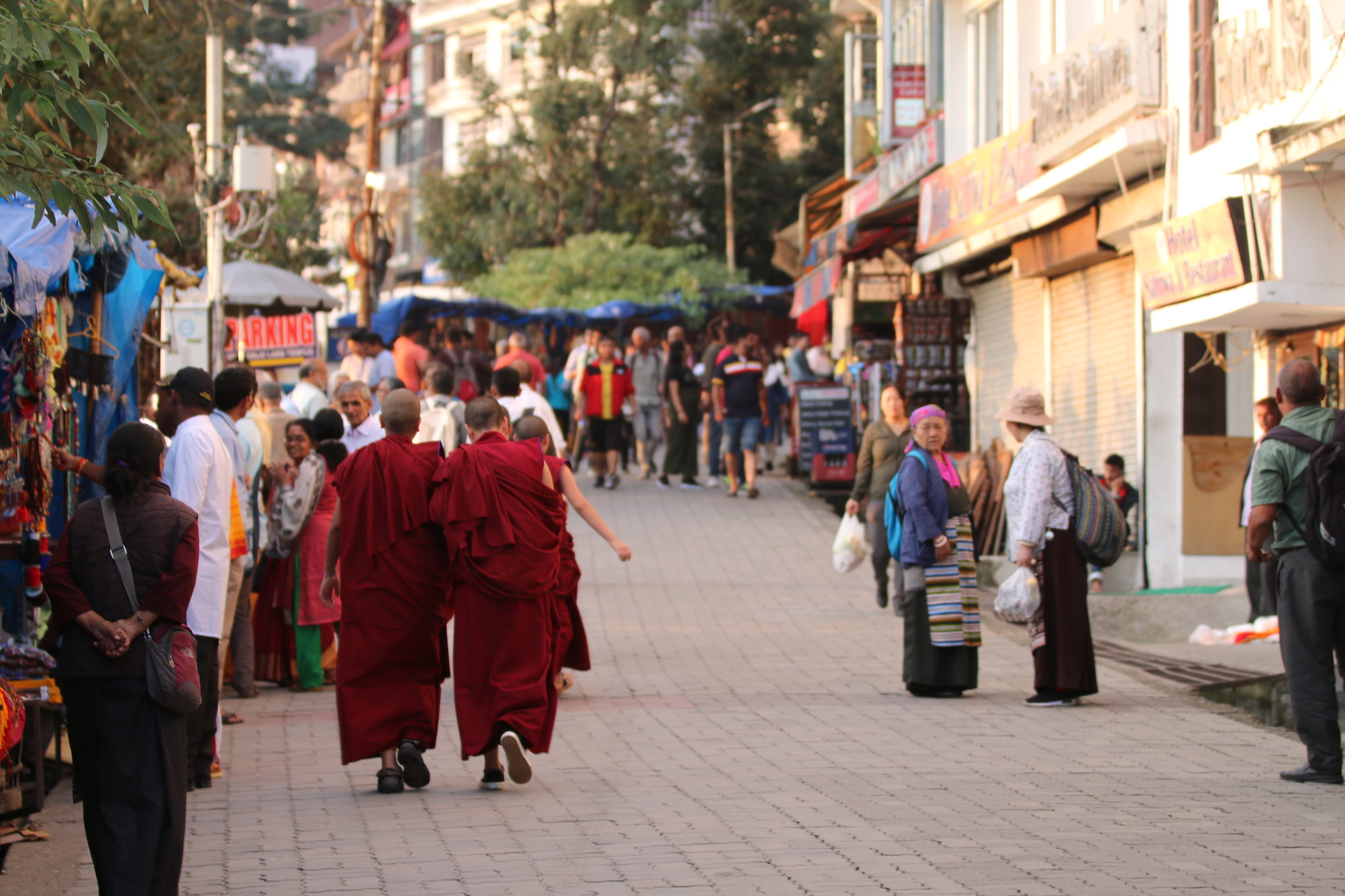 "The streets of McLeodganj in Dharamshala are famous for Tibetan Buddhist monks clad in their crimson robes. The place is also called ""mini Lhasa"" after the Tibetan capital and is the home of the exiled Dalai Lama. Photo by Avinash Giri."